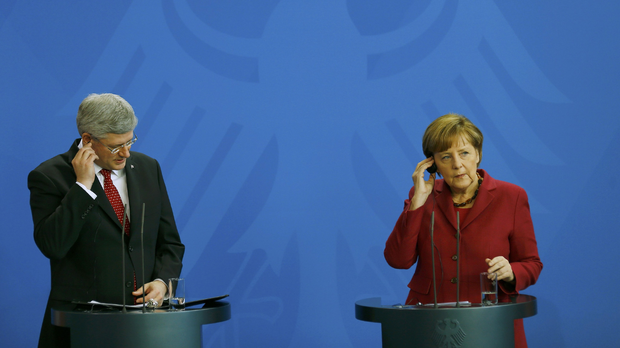 German Chancellor Merkel and Canadian Prime Minister Harper address joint news conference at Chancellery in Berlin...German Chancellor Angela Merkel and Canadian Prime Minister Stephen Harper address a joint news conference at the Chancellery in Berlin March 27, 2014.               REUTERS/Kai Pfaffenbach (GERMANY  - Tags: POLITICS)