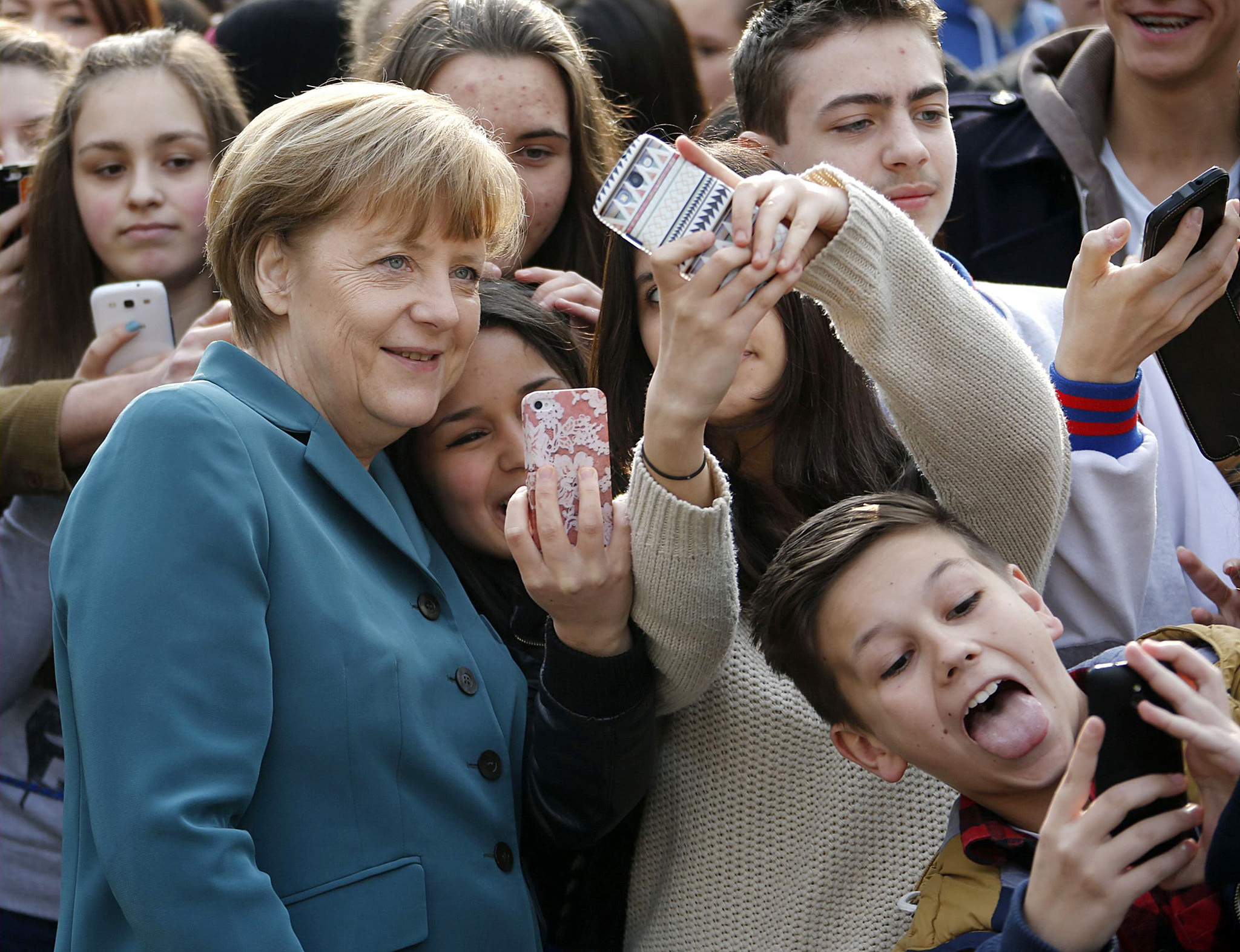 "REUTERS PICTURE HIGHLIGHT...ATTENTION EDITORS - REUTERS PICTURE HIGHLIGHT TRANSMITTED BY 0904 GMT ON MARCH 31, 2014    FAB01  Pupils take mobile phone 'selfies' with German Chancellor Angela Merkel, as she arrives for a visit at Robert-Jungk Europe high school as part of the Europe-Project Day, in Berlin.   REUTERS/Fabrizio Bensch     REUTERS NEWS PICTURES HAS NOW MADE IT EASIER TO FIND THE BEST PHOTOS FROM THE MOST IMPORTANT STORIES AND TOP STANDALONES EACH DAY. Search for ""TPX"" in the IPTC Supplemental Category field or ""IMAGES OF THE DAY"" in the Caption field and you will find a selection of 80-100 of our daily Top Pictures."