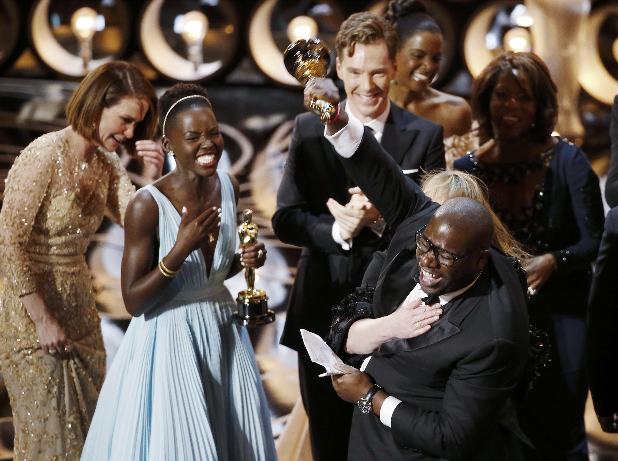 "REUTERS PICTURE HIGHLIGHT...ATTENTION EDITORS - REUTERS PICTURE HIGHLIGHT TRANSMITTED BY 0550 GMT ON MARCH 3, 2014    OSC1473  Director and producer Steve McQueen (R) celebrates after accepting the Oscar for best picture for his film ""12 Years a Slave"", with actress Lupita Nyong'o (L), at the 86th Academy Awards in Hollywood, California.  REUTERS/Lucy Nicholson     REUTERS NEWS PICTURES HAS NOW MADE IT EASIER TO FIND THE BEST PHOTOS FROM THE MOST IMPORTANT STORIES AND TOP STANDALONES EACH DAY. Search for ""TPX"" in the IPTC Supplemental Category field or ""IMAGES OF THE DAY"" in the Caption field and you will find a selection of 80-100 of our daily Top Pictures."
