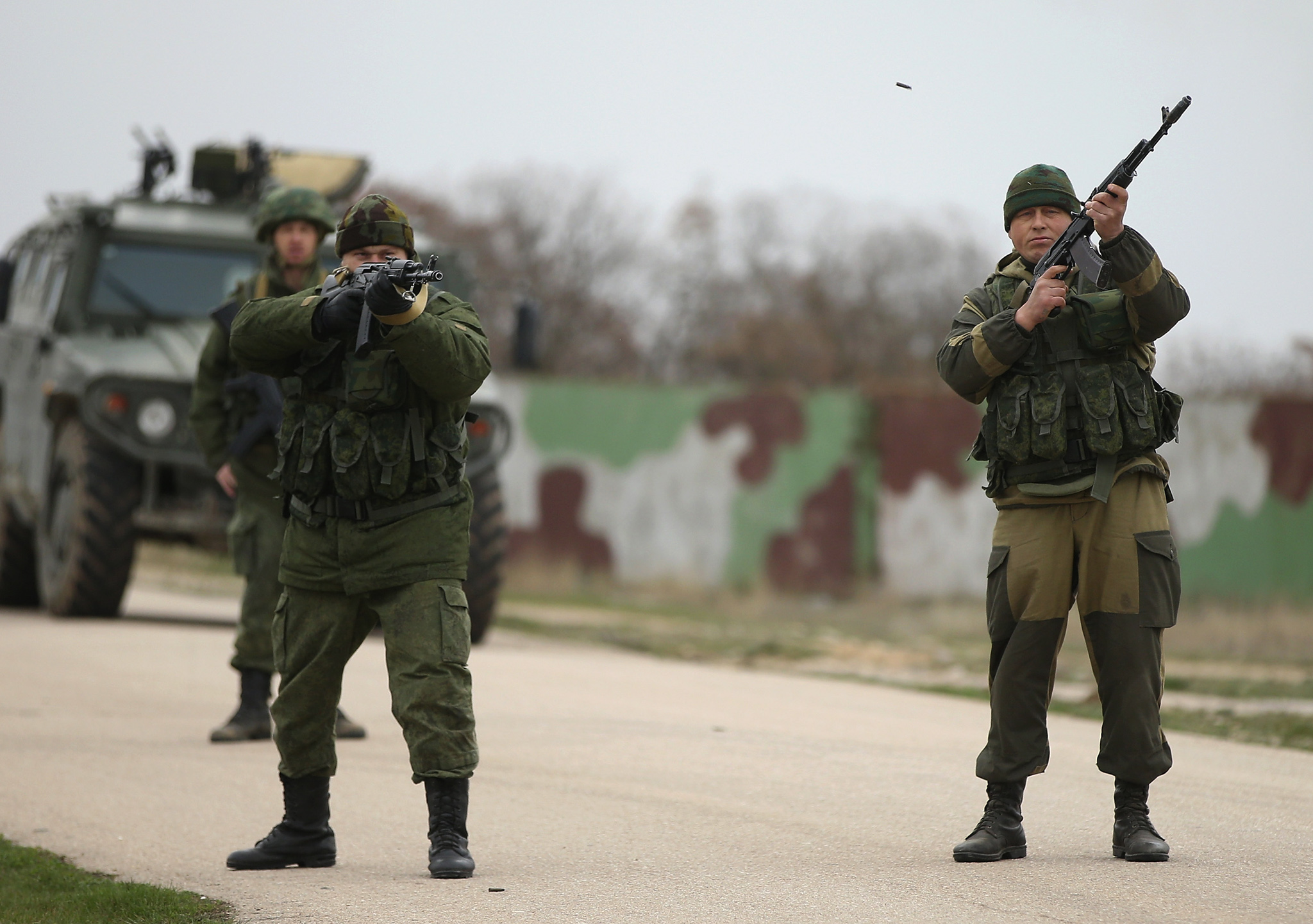 Troops under Russian command fire weapons into the air and scream orders to turn back at an approaching group of over 100 hundred unarmed Ukrainian troops at the Belbek airbase, which the Russian troops are occcupying, in Crimea, Ukraine. The Ukrainians are stationed at their garrison nearby, and after spending a tense night anticipating a Russian attack following the expiration of a Russian deadline to surrender, their commander Colonel Yuli Mamchor announced his bold plan this morning to retake the airfield by confronting the Russian-lead soldiers unarmed. The Russian-lead troops fired their weapons into the air but then granted Mamchor the beginning of negotiations with their commander.