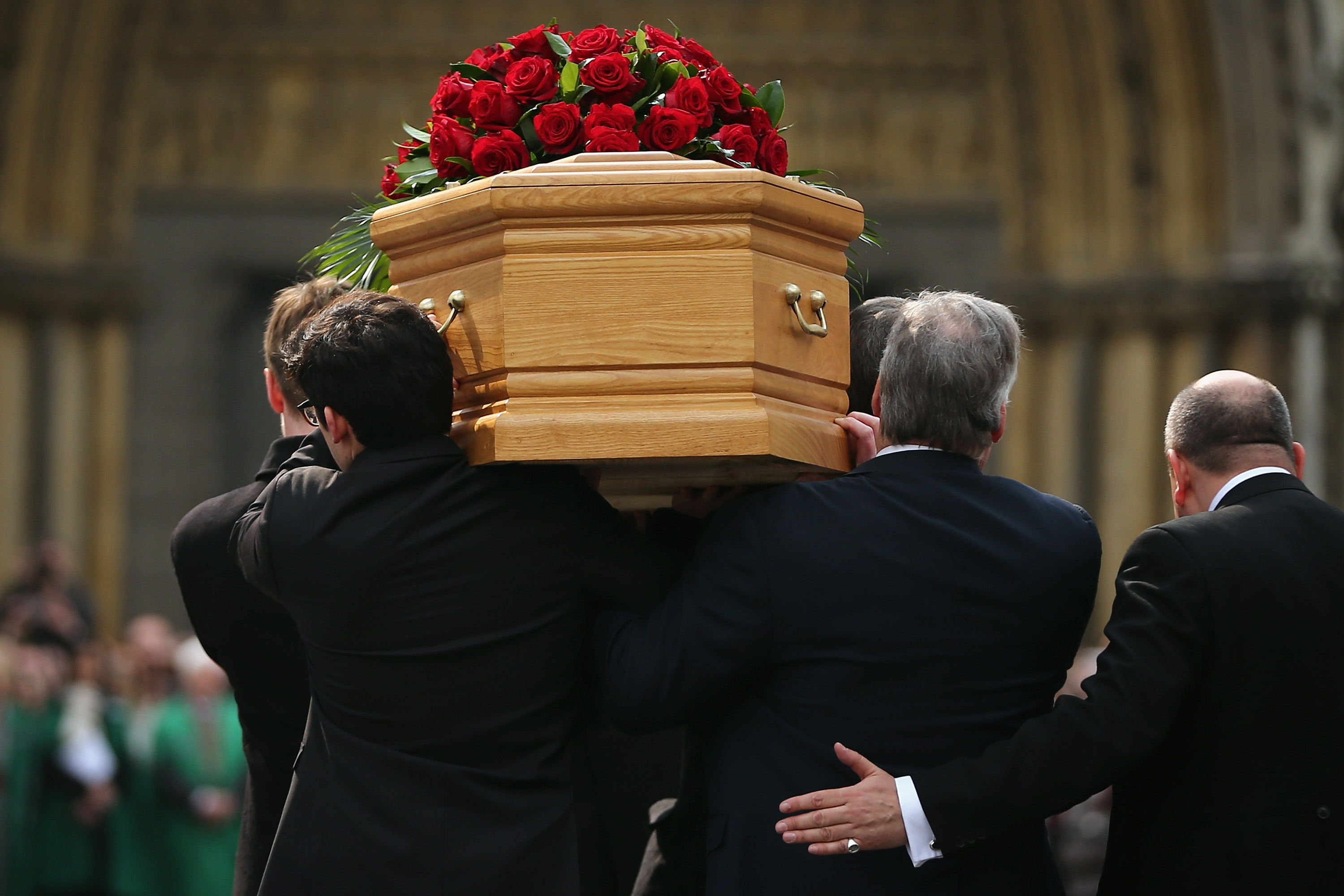 The coffin of the late Tony Benn is carried into the grounds of Westminster Abbey and St Margaret's Church for his funeral in London, England. Former Labour cabinet minister and opponent to the Iraq War Tony Benn, died at the age of 88 on March 14, 2014.
