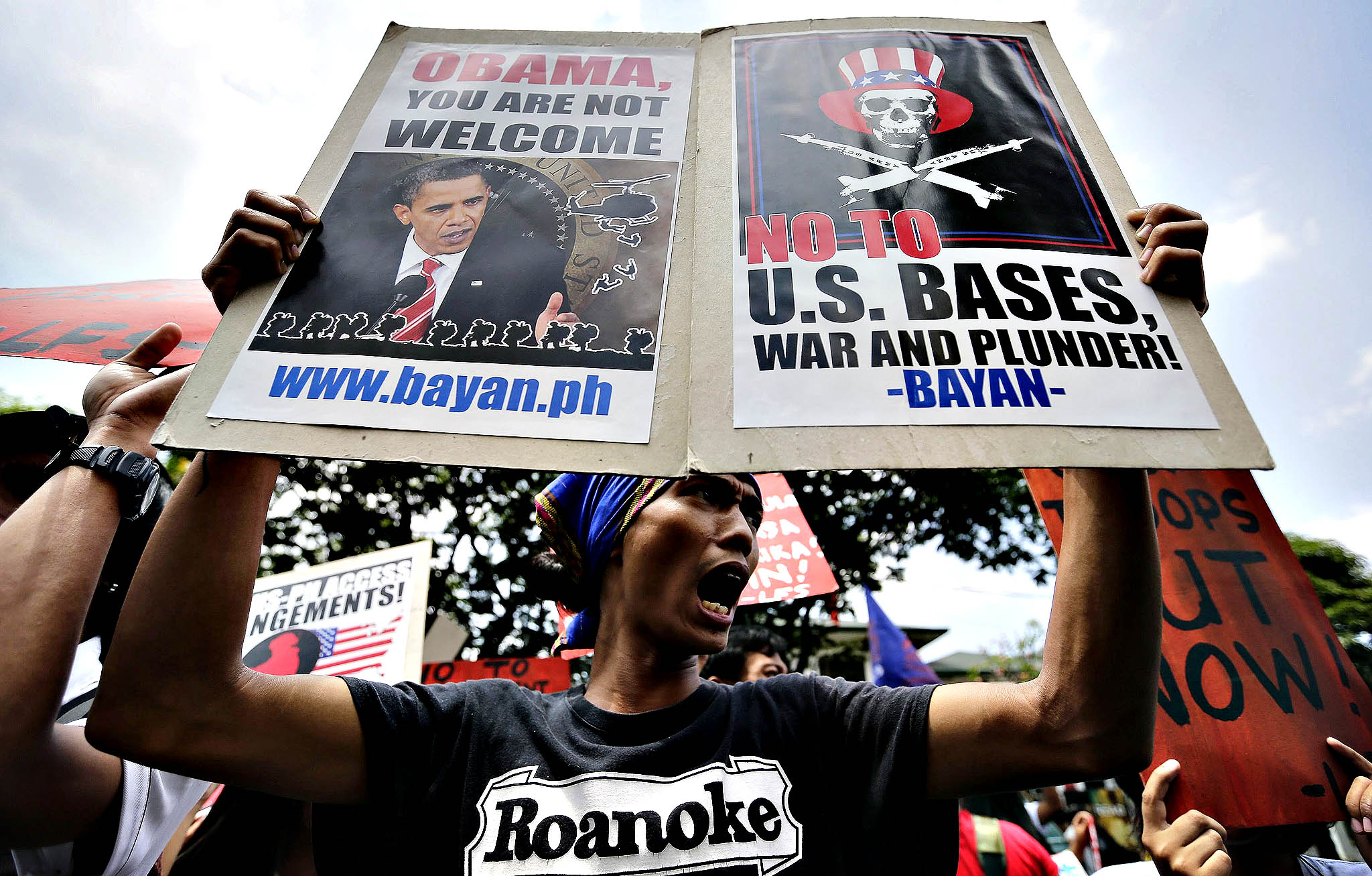 A Filipino student shouts anti-US slogans outside the US embassy in Manila, Philippines, 21 March 2014 in a rally condemning the docking of the USS Blue Ridge and the upcoming visit of US President Barack Obama to the country. Activists also called for an end to the presence of US troops in the country and the Visiting Forces Agreement (VFA). Obama is to visit Japan, South Korea, Malaysia and the Philippines in late April. The trip is part of his efforts to broaden US engagement in the Asia-Pacific region on all fronts, from strategic security issues to trade and diplomacy. Obama had originally planned an Asia trip for late 2013, but was forced to cancel during the budget and debt limit crisis that closed the US government for more than two weeks in October.