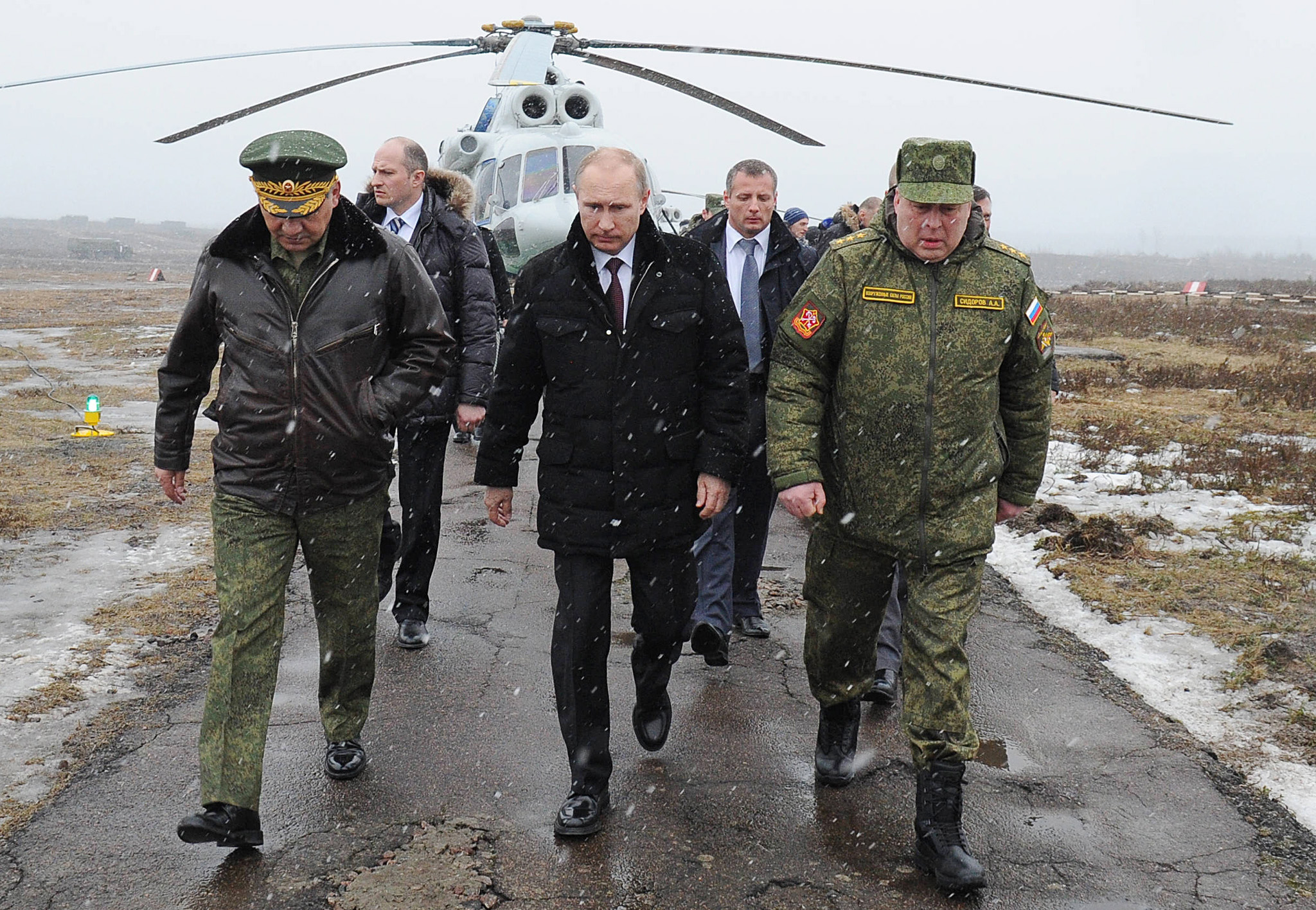 Vladimir Putin, Sergei Shoigu, Anatoly Sidorov...Russian President Vladimir Putin, center, and Defense Minister Sergei Shoigu, left, and the commander of the Western Military District Anatoly Sidorov, right, walk upon arrival to watch military exercise near St.Petersburg, Russia, Monday, March 3, 2014. Putin has sought and quickly got the Russian parliament's permission to use the Russian military in Ukraine.