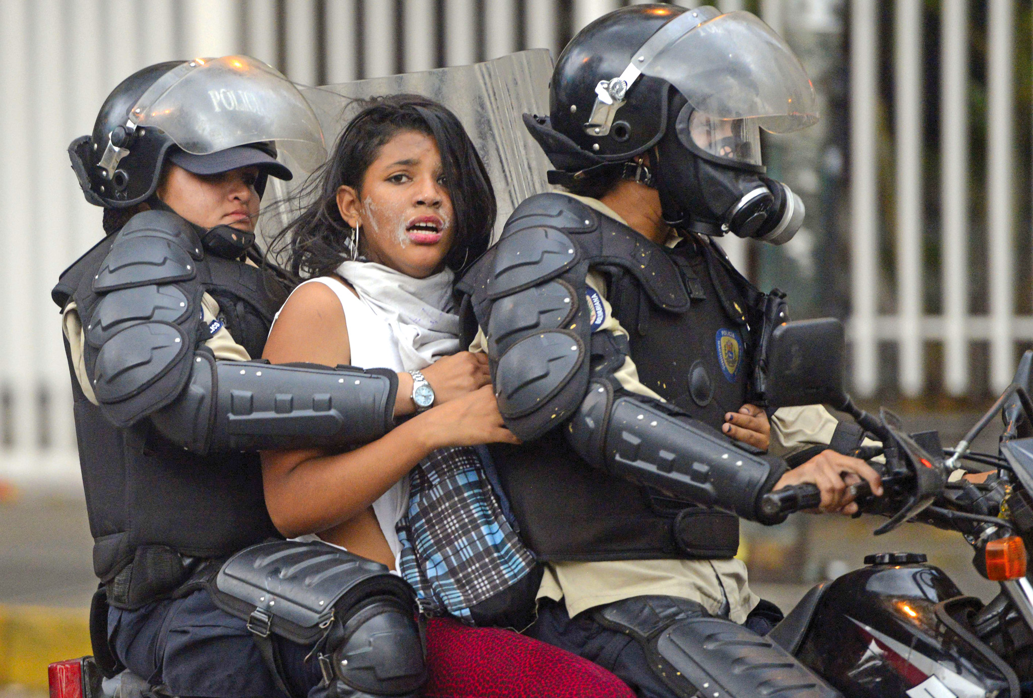 TOPSHOTS An anti-government activist is ...TOPSHOTS An anti-government activist is arrested by national police during a protest against Venezuela President Nicolas Maduro government in Caracas on March 13, 2014. A total of 28 people have been killed and 365 inju