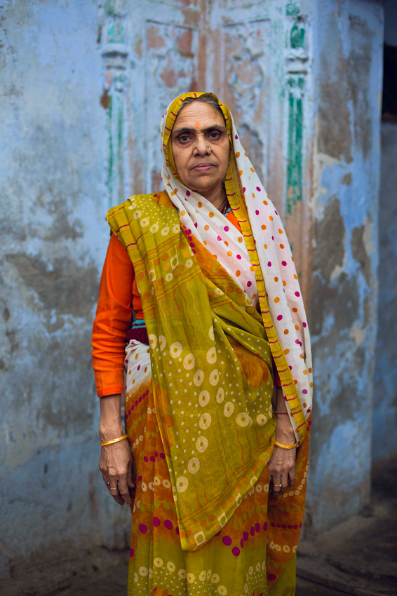 In this photograph taken on March 5, 201...In this photograph taken on March 5, 2014, sixty-five year old Indian widow Urmila Tiwari poses at the Meerasahabhagini Ashram in Vrindavan, some 135 kilometres (80 miles) south of New Delhi, ahead of International Women's Day. Tiwari has lived at the ashram for over a year and says, I love to live here, among good people. Banished by families who see them as a financial drain, or believe they bring bad fortune, desperately poor widows have for centuries travelled to the northern city of Vrindavan, where the Hindu god Krishna is said to have grown up, to pray and wait to die. Traditionally, Vrindavans widows sung hymns and begged in the pilgrimage city on the banks of the Yamuna River, living in seclusion and shame and expected to dress in white, signifying the loss of colour from their lives. The Meerasahabhagini Ashram run by the Sulabh International NGO offers a place where some of Vrindavans estimated 15,000 widows can live together, providing support and friendship that bind them into a community. International Women's Day falls on March 8.