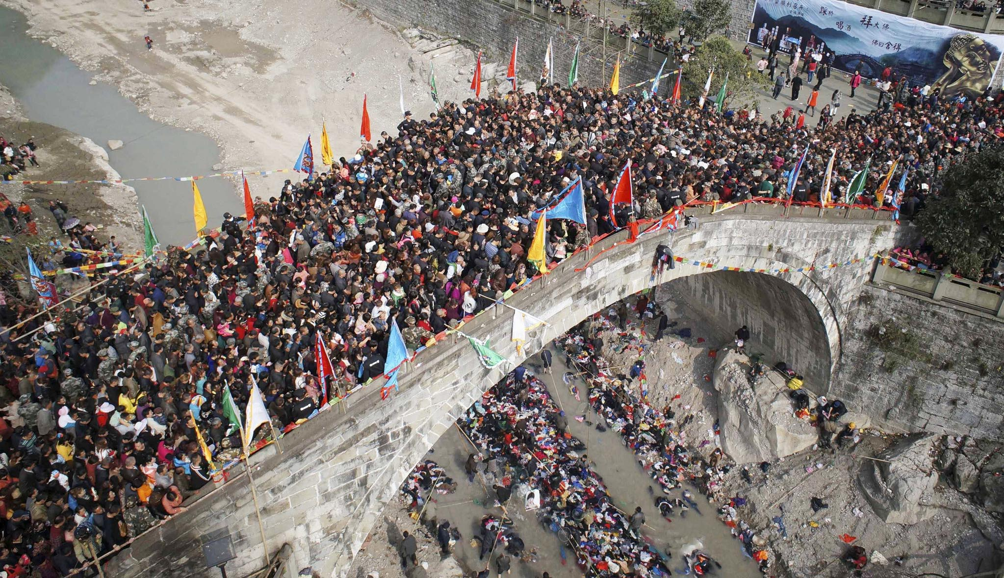 People crowd onto a bridge during the annual Caiqiaohui event in Mianyang