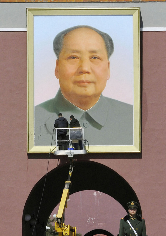 Workers clean black marks off the portrait of China's late leader Mao Zedong at the main entrance of the Forbidden City near the Great Hall of the People where the NPC is taking place, at Tiananmen Square in Beijing...Workers clean black marks off the portrait of China's late leader Mao Zedong at the main entrance of the Forbidden City near the Great Hall of the People where the National People's Congress (NPC) is taking place, at Tiananmen Square in Beijing, in this photo taken by Kyodo March 6, 2014. The portrait appeared to have been vandalized, Kyodo news reported. Mandatory credit REUTERS/Kyodo (CHINA - Tags: POLITICS CRIME LAW) ATTENTION EDITORS - FOR EDITORIAL USE ONLY. NOT FOR SALE FOR MARKETING OR ADVERTISING CAMPAIGNS. THIS IMAGE HAS BEEN SUPPLIED BY A THIRD PARTY. IT IS DISTRIBUTED, EXACTLY AS RECEIVED BY REUTERS,