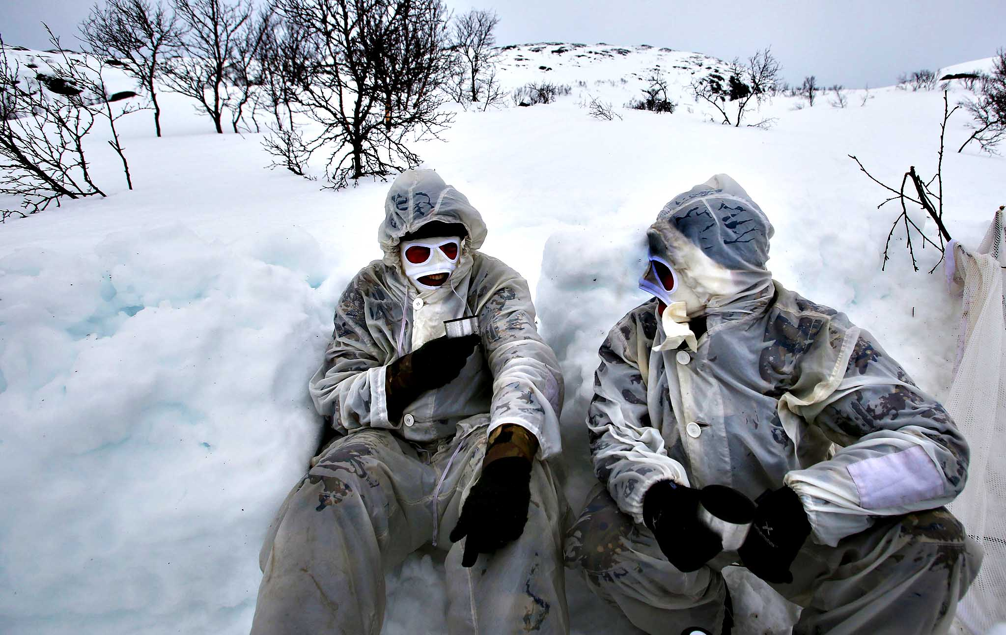 Marine reservists James Mullard (right) from Rosyth Scotland and Ed Dutton (left) from Plymouth taking a rest during a ski patrol in the hills of Harstad, Northern Norway, in the Arctic Circle as part of their Cold Weather Survival training which lasts for two weeks. PRESS ASSOCIATION Photo. Picture date: Monday March 17, 2014.