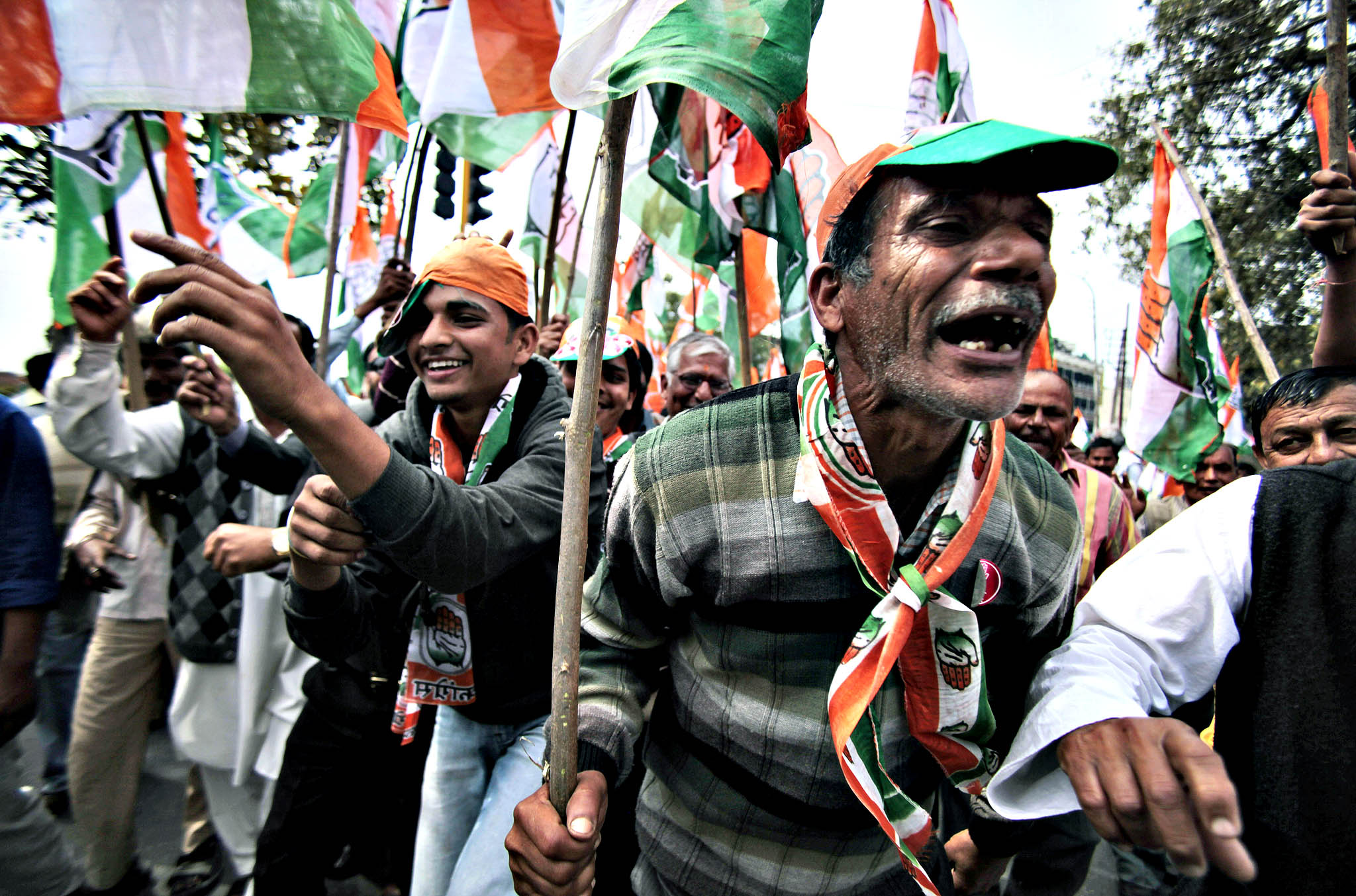 Congress party supporters accompany a party nominee to file nomination papers for the upcoming parliamentary elections in Jammu, India, Thursday, March 20, 2014. India will hold national elections from April 7 to May 12, kicking off a vote that many observers see as the most important election in more than 30 years in the world's largest democracy.