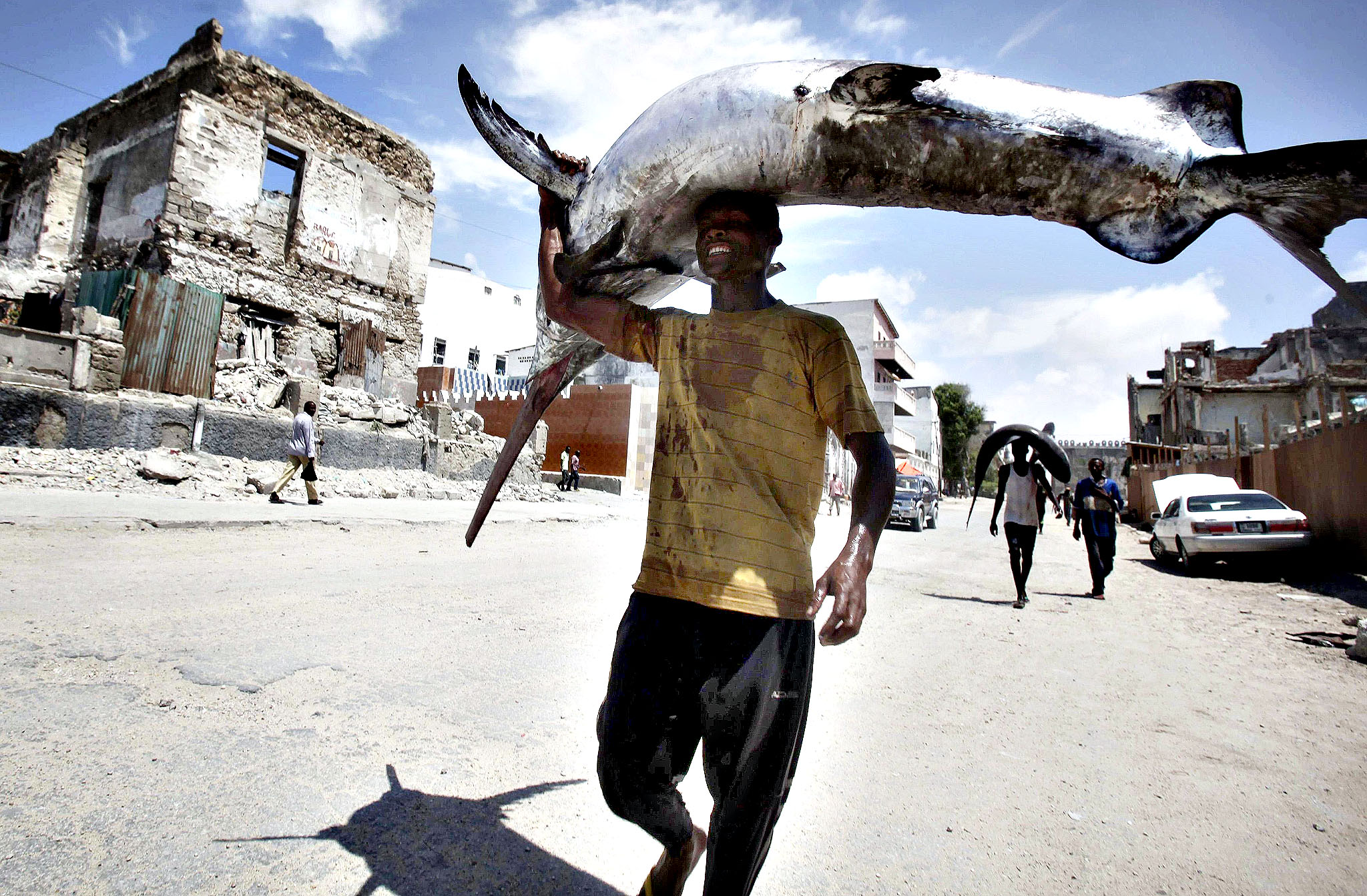 A fisherman carries a swordfish on his head from the Indian Ocean waters to the market in Somalia's capital Mogadishu March 31, 2014.