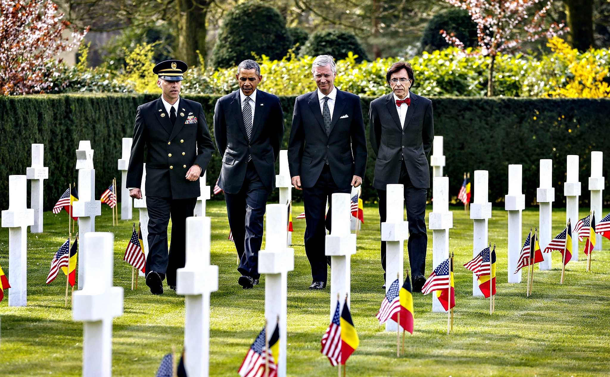 "A US army officer escorts US President Barack Obama (2nd-L), Belgium's King Philippe (2nd-R) and Belgian Prime Minister Elio Di Rupo (R) as they visit the WWI Flanders Field Cemetery in Waregem on Wednesday. The cemetery is the final resting place for 368 Americans, most of whom were killed during World War I. Obama will pay his first visit ever to the EU headquarters in Brussels, cementing US-EU opposition to the takeover of Crimea after hitting out at Russian expansionism as a ""sign of weakness""."