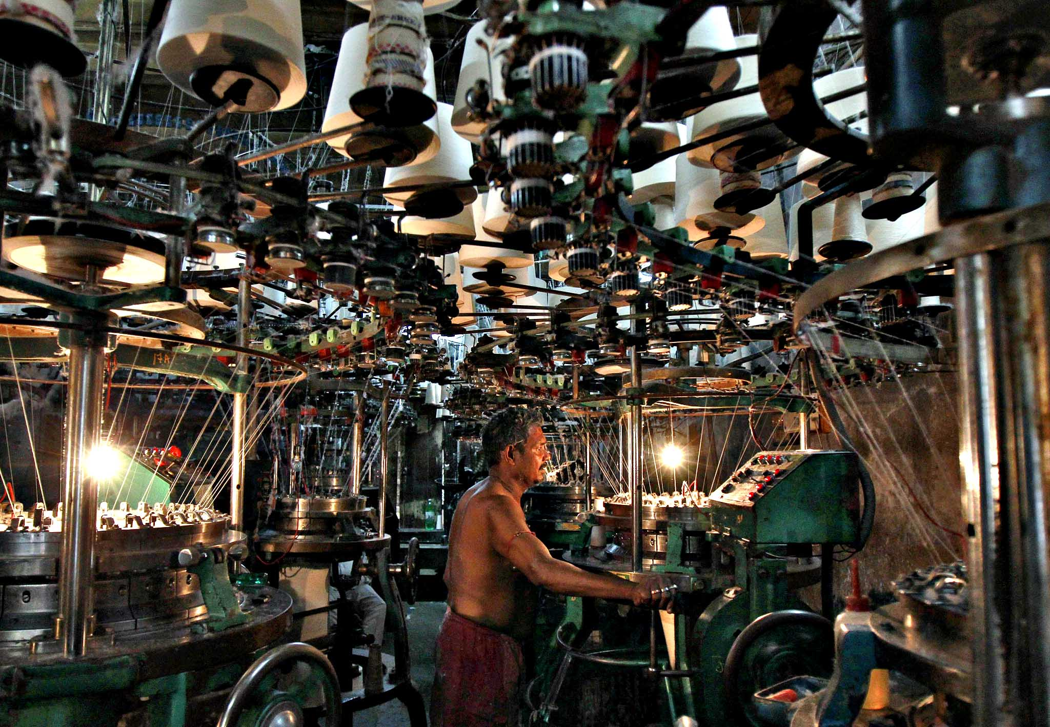 An employee works inside an undergarment factory in Kolkata March 10, 2014.