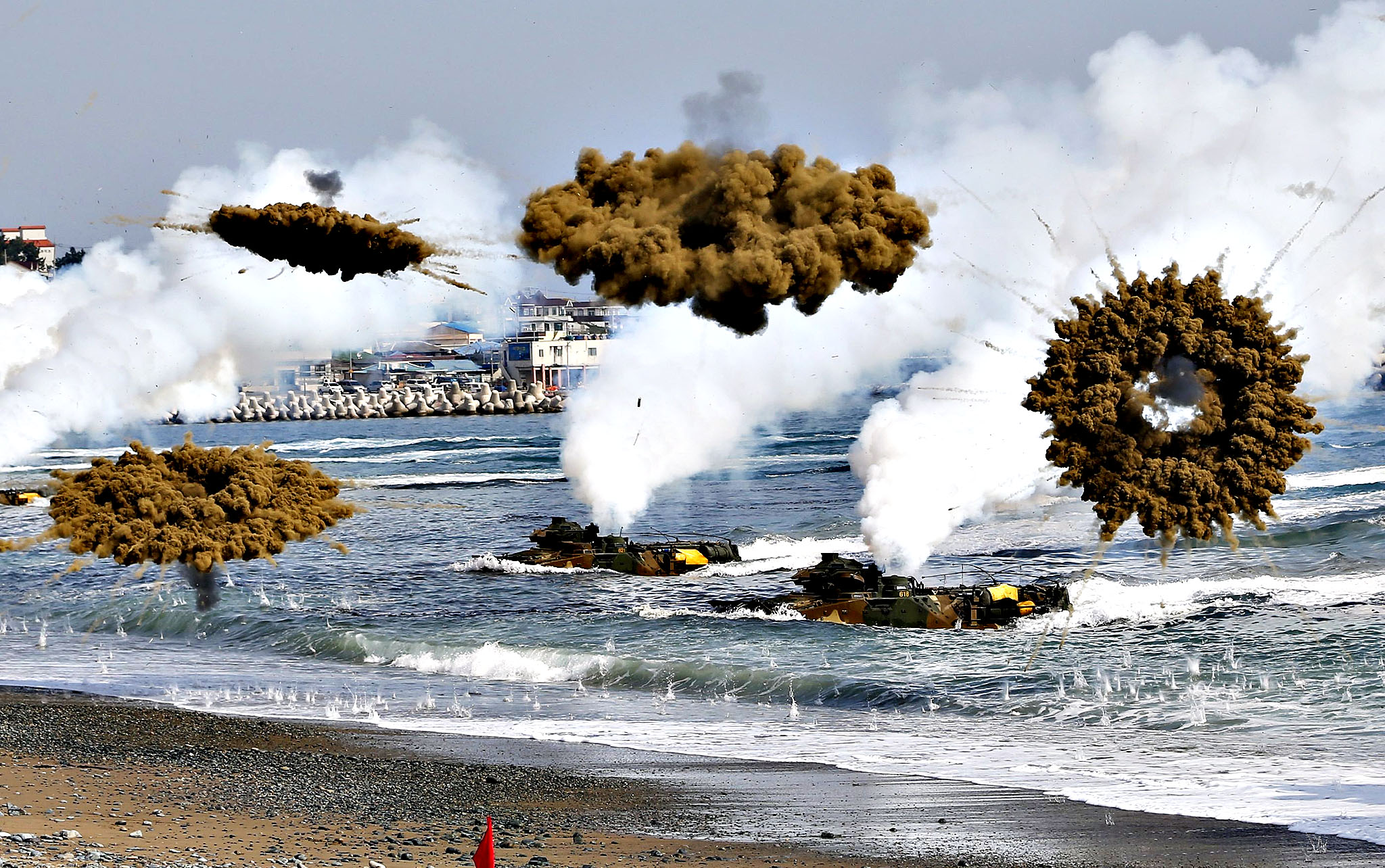 Amphibious assault vehicles of the South Korean Marine Corps throw smoke bombs as they move to land on shore during a U.S.-South Korea joint landing operation drill in Pohang...Amphibious assault vehicles of the South Korean Marine Corps throw smoke bombs as they move to land on shore during a U.S.-South Korea joint landing operation drill in Pohang March 31, 2014. The drill is part of the two countries' annual military training called Foal Eagle, which began on February 24 and runs until April 18.  North Korea declared a no-sail warning on Monday for areas off its west coast near a disputed border with South Korea and has notified the South that it will conduct firing drills, a South Korean government official said. The warning comes amid heightened tensions surrounding the North after the U.N. Security Council condemned Pyongyang for its mid-range missile launches last week, just as the leaders of South Korea, Japan and the United States met to discuss the North's arms programme.