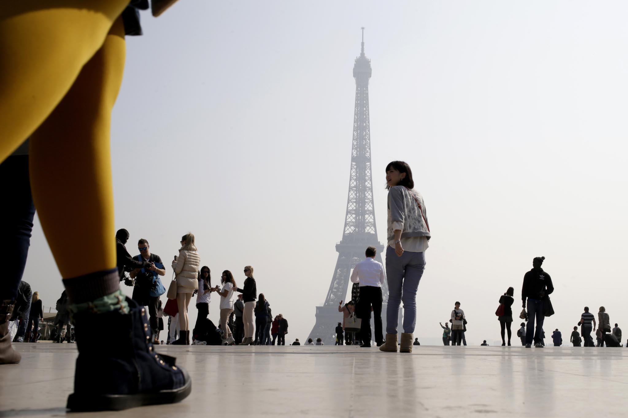 the Eiffel tower in central Paris through a haze of pollution.