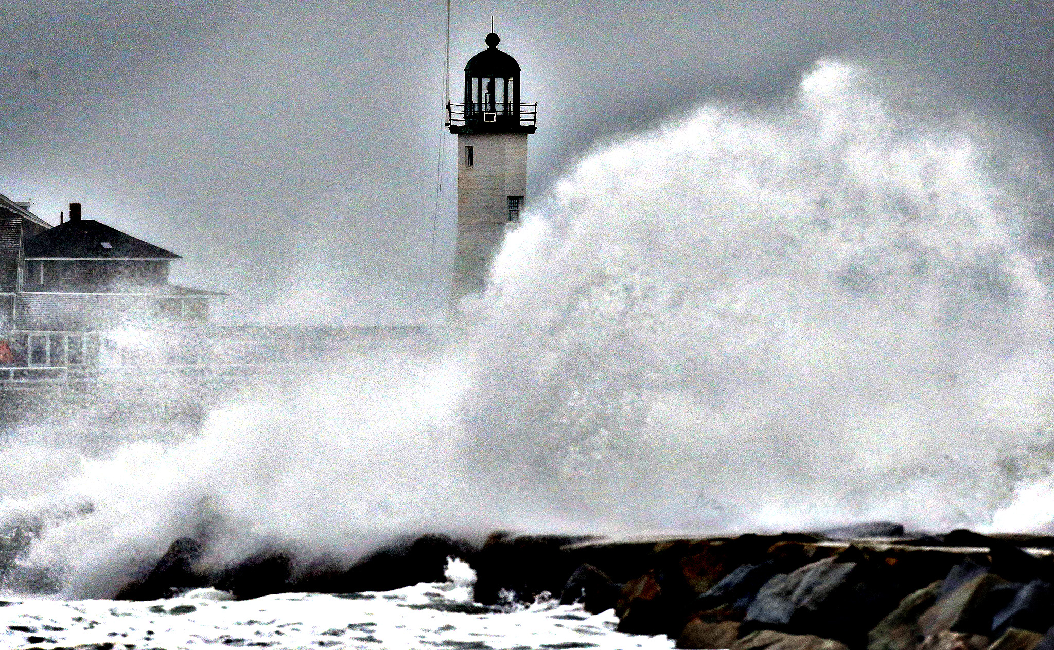 Wind-driven waves crash on a sea wall in Scituate, Mass., Wednesday, March 26, 2014. Cape Cod and the islands were expected to bear the brunt of the spring storm that struck full force Wednesday. The storm could drop up to 10 inches of snow.