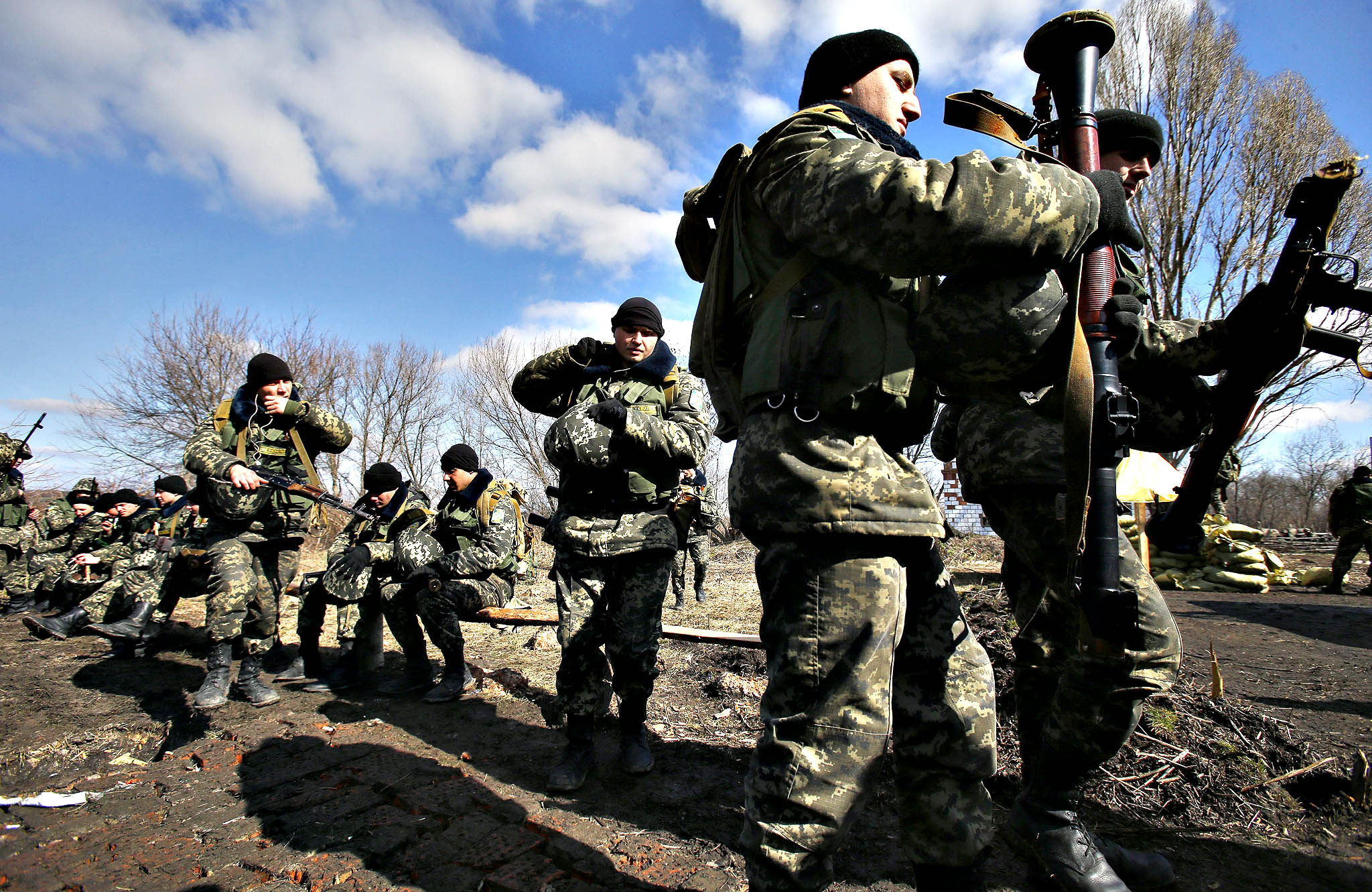 Ukrainian border guards prepare for a training session at a military camp in the village of Alekseyevka on the Ukrainian-Russian border, eastern Ukraine, Friday, March 21, 2014. Russian President Vladimir Putin signed bills on Friday making Crimea part of Russia, completing the annexation from Ukraine.