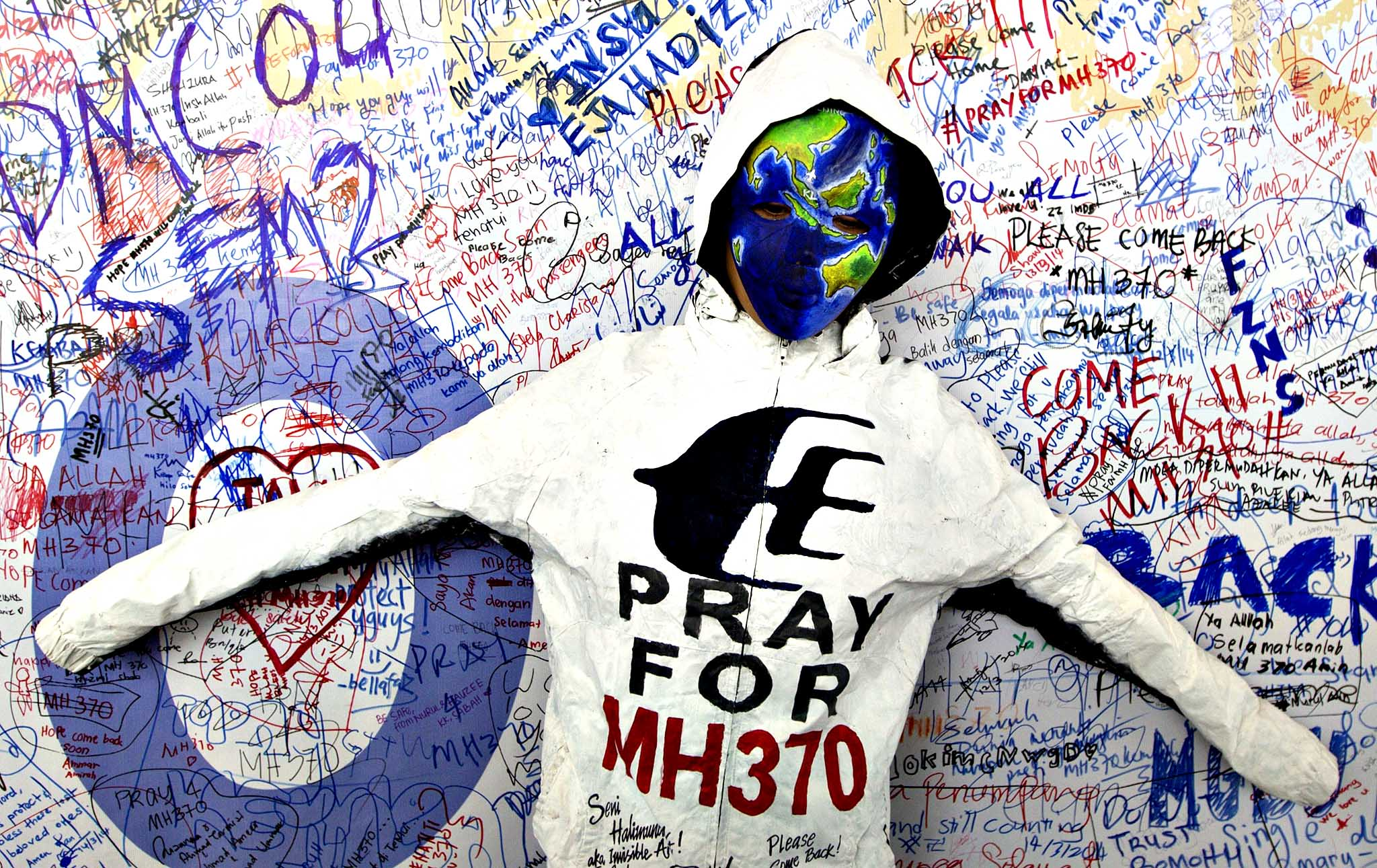 An artwork by Malaysian artist Safirah Rashid is seen at the Wall of Hope for the passengers of the missing Malaysian Airlines plane at Kuala Lumpur International Airport, Malaysia, 17 March 2014. China sharply criticized Malaysia for its handling of an investigation into the disappearance of a commercial aircraft with 239 people aboard nine days ago. The criticism came as a Malaysian police source ruled out a connection between the pilot's political affiliations and the disappearance of Malaysia Airlines flight MH 370.
