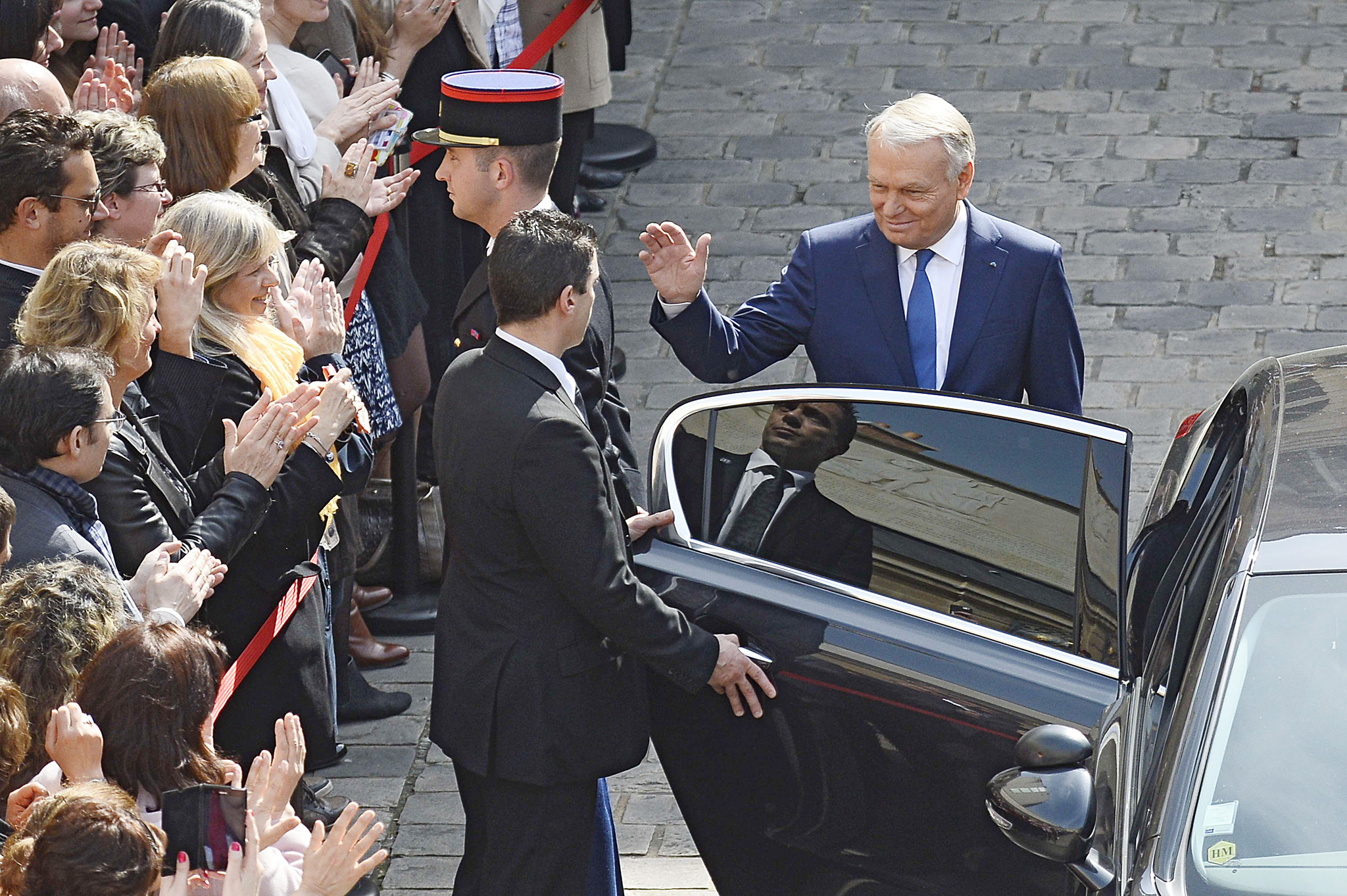 France's outgoing Prime minister Jean-Ma...France's outgoing Prime minister Jean-Marc Ayrault (R) waves as he leaves the Hotel Matignon after the take over ceremony, on April 1, 2014 at in Paris. France's new Prime Minister Manuel Valls faced a delicate balancing act as he set about forming a new government tasked with reviving the economy and reining in public financesAFP PHOTO / LIONEL BONAVENTURELIONEL BONAVENTURE/AFP/Getty Images