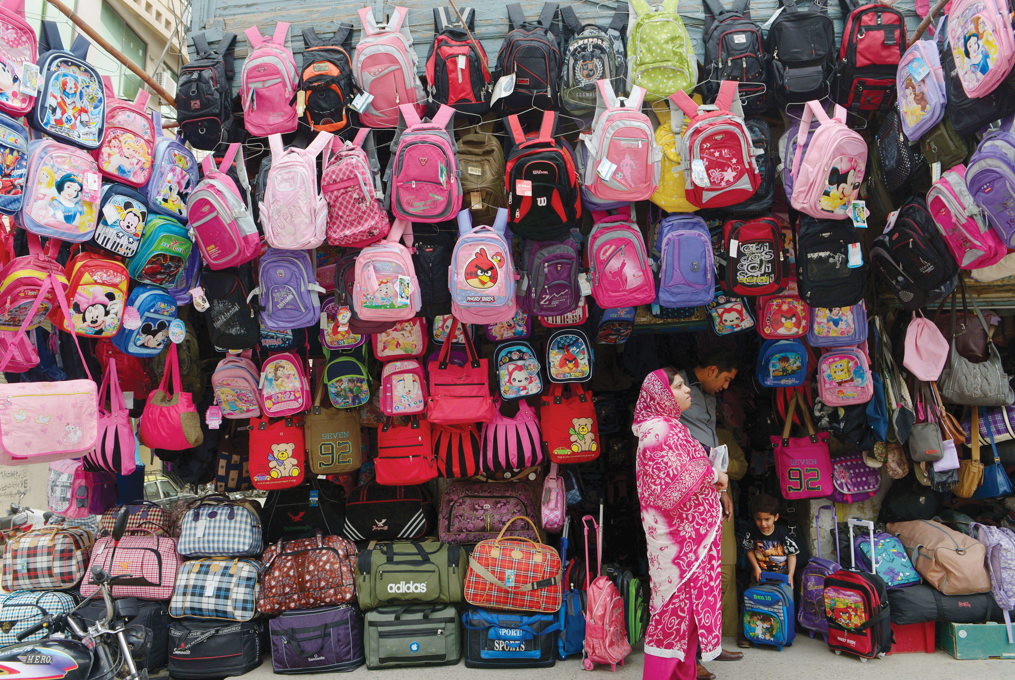 TOPSHOTS A Pakistani family chooses a sc...TOPSHOTS A Pakistani family chooses a school bag at a shop in Rawalpindi on April 15, 2014. Pakistan has re-entered the international bond market after a seven-year gap, the finance ministry said Wednesday, raising $2 billion to boost dwindling foreign exchange reserves and shore up the rupee.  AFP PHOTO/Farooq NAEEMFAROOQ NAEEM/AFP/Getty Images