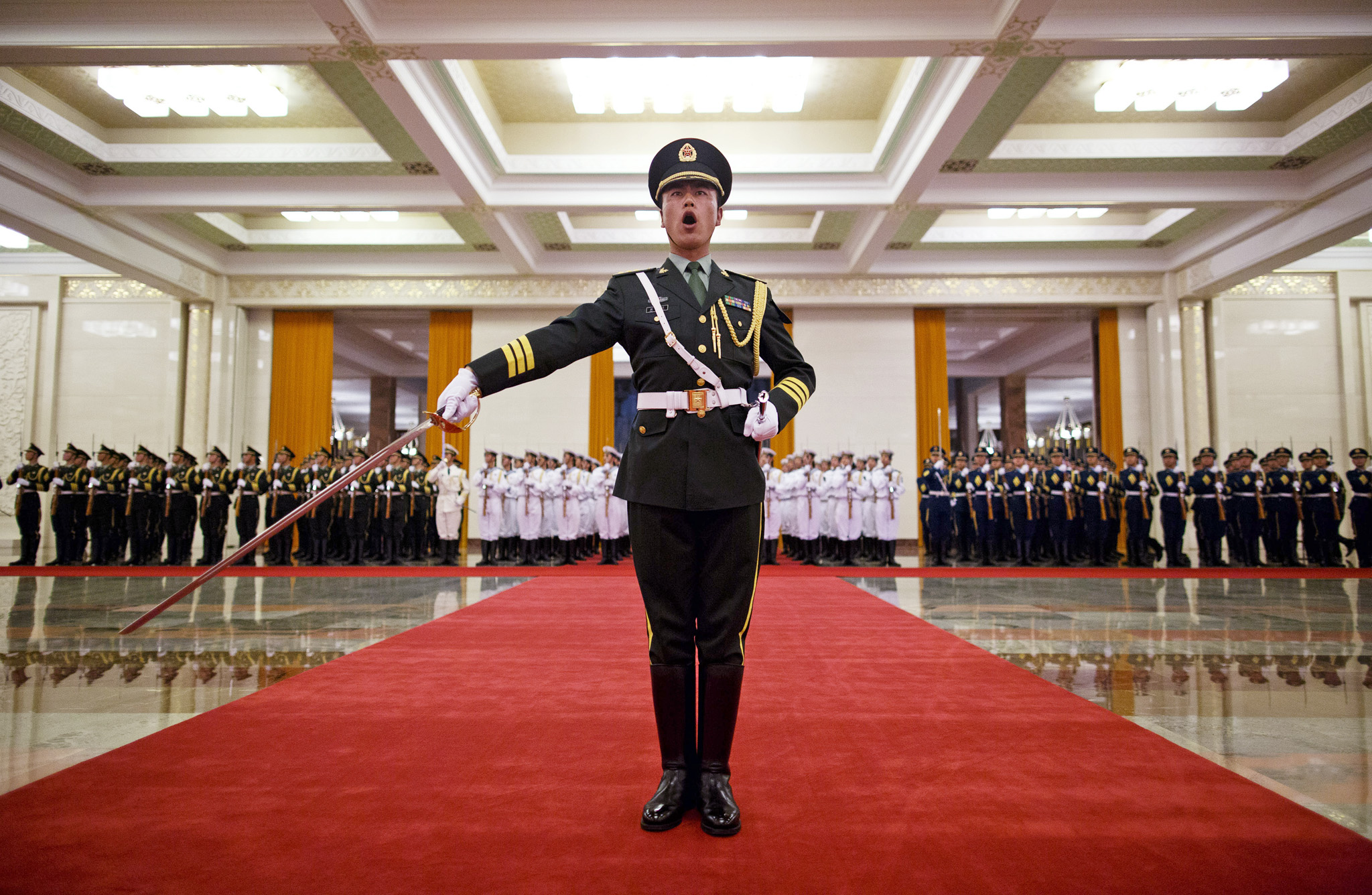 Members of an honor guard rehearse before a welcome ceremony held by Chinese President Xi Jinping for visiting Israeli President Shimon Peres at the Great Hall of the People in Beijing Tuesday, April 8, 2014. (AP Photo/Alexander F. Yuan)