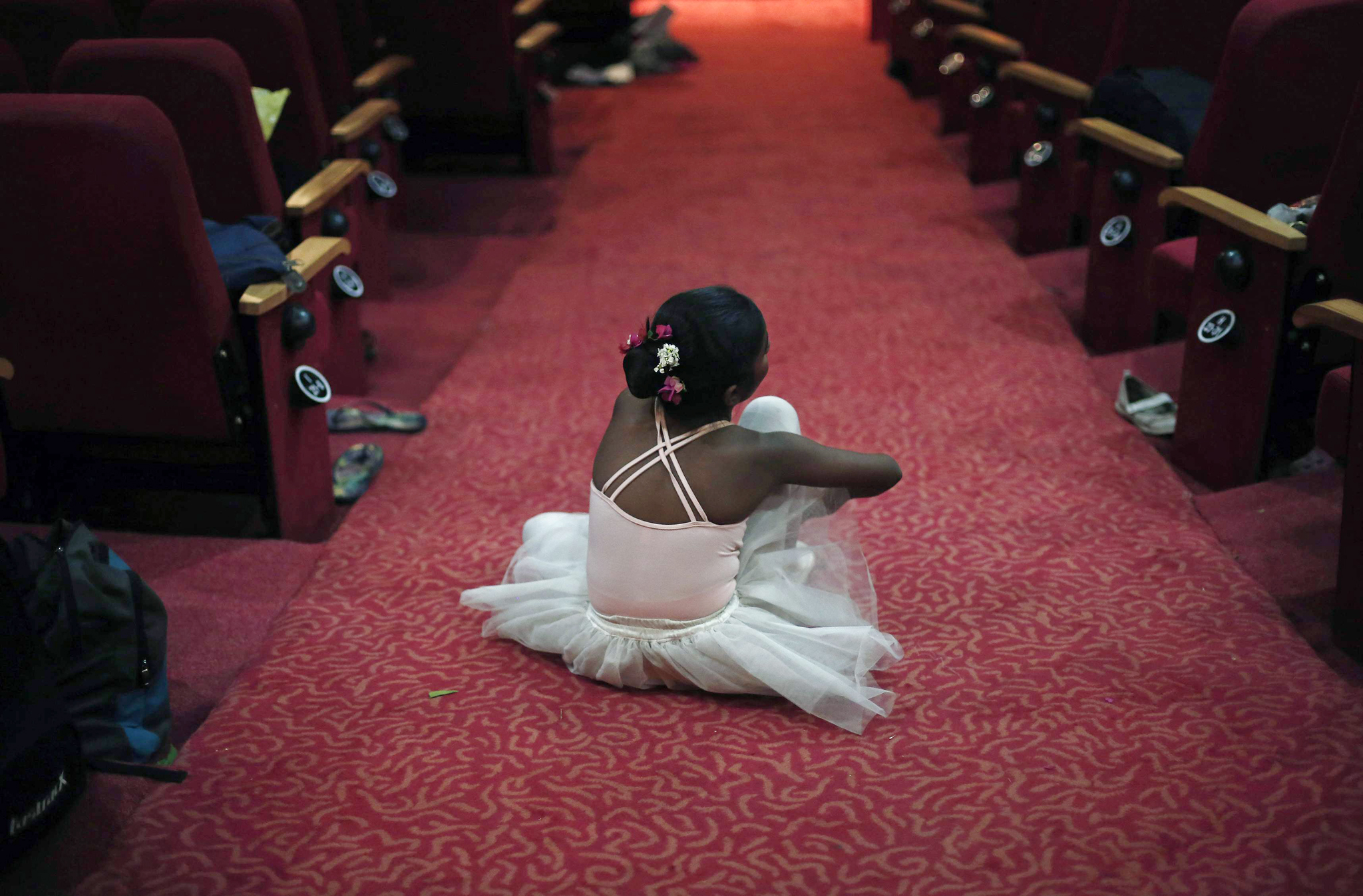 A girl sits backstage after getting ready for her dance recital to celebrate International Dance Day, in New Delhi April 29, 2014. REUTERS/Adnan Abidi