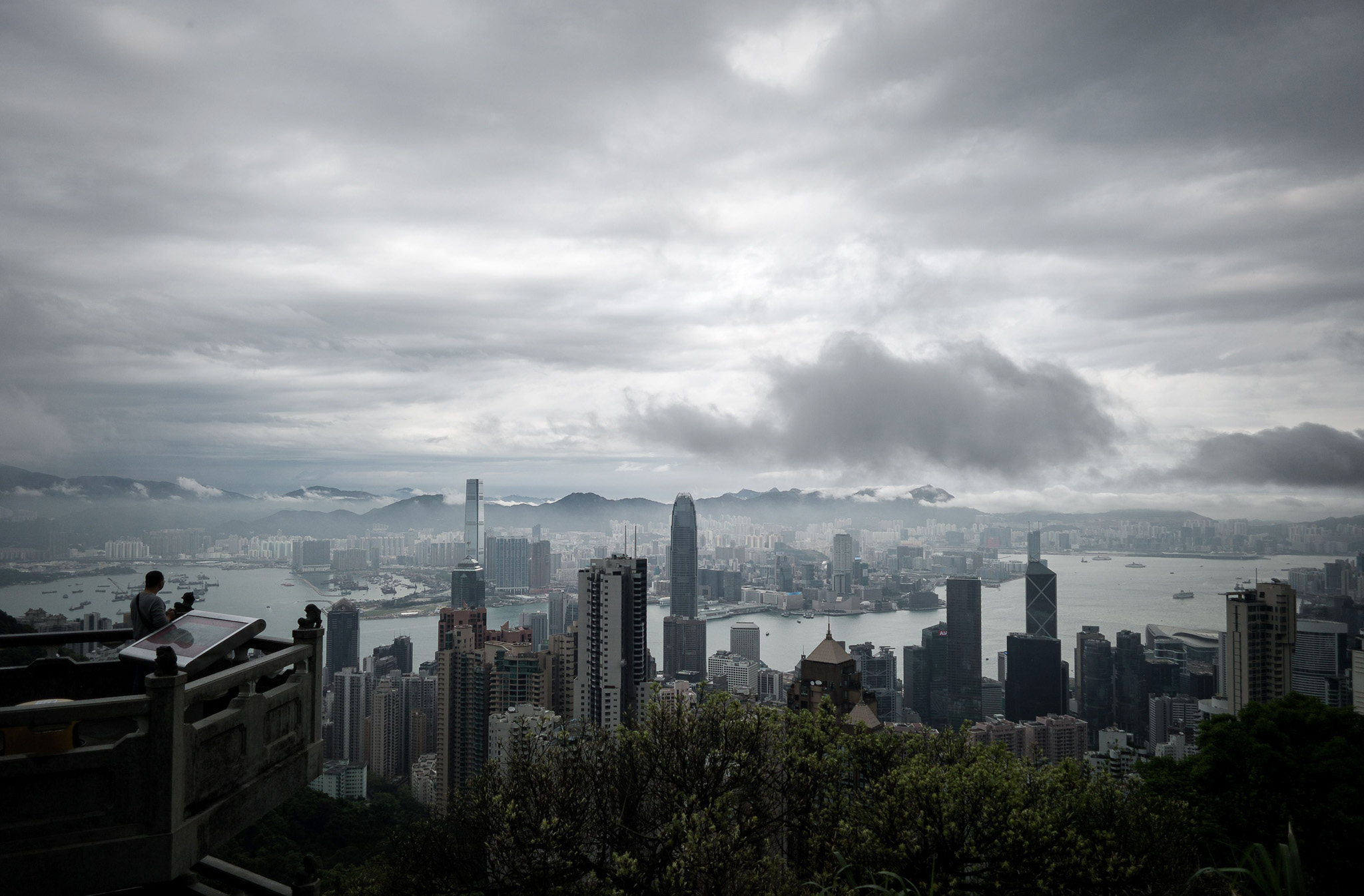 A man (L) looks at the city's skyline as...A man (L) looks at the city's skyline as a storm approaches in Hong Kong on April 2, 2014. Stormy weather is affecting the city due to a trough of low pressure on coastal areas of neighbouring Guangdong province in southern China. AFP PHOTO / Philippe LopezPHILIPPE LOPEZ/AFP/Getty Images