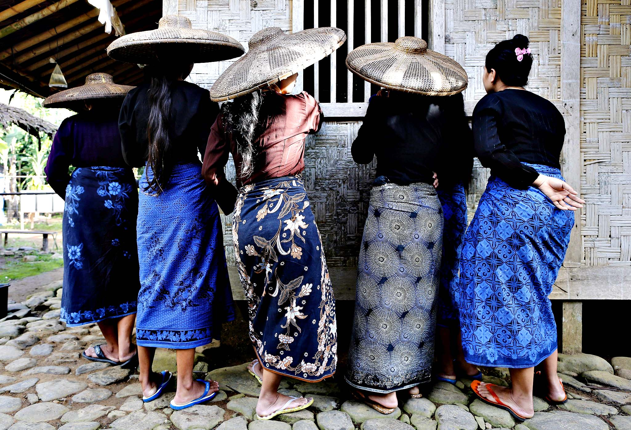 Indonesian Baduy tribe women wait for their turn to cast their ballots during the parliamentary elections at a polling station in Kanekes village, Lebak, Banten province, Indonesia, 09 April 2014. Polls opened on 09 April in Indonesia's parliamentary elections amid expectations of an opposition victory. Twelve national political parties and three local parties in Aceh province are contesting the elections, the fourth since Indonesia embraced democracy following the fall of dictator Suharto in 1998.