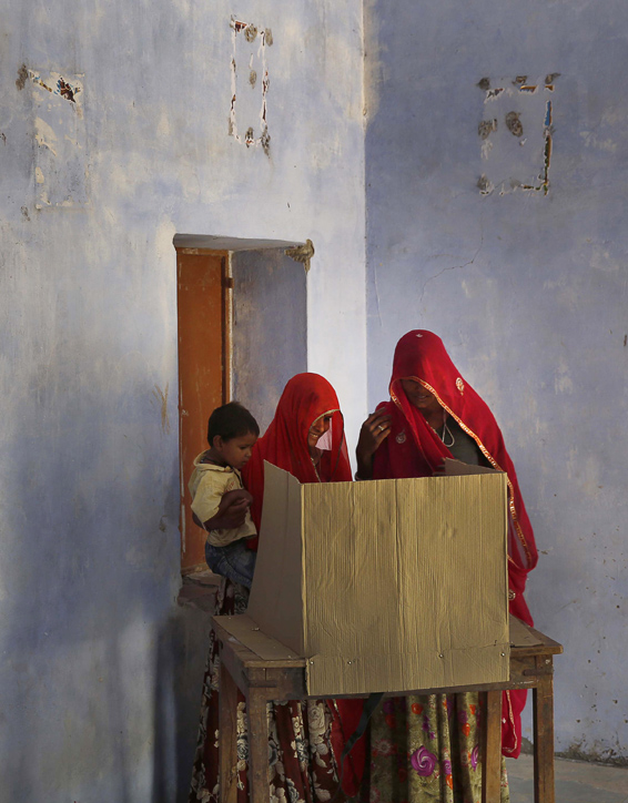 Indian women cast their vote during the sixth phase of polling of the Indian parliamentary elections at a village near Sawai Madhopur, Rajasthan state, India, Thursday, April 24, 2014. With 814 million eligible voters, India is voting in phases over six weeks. Results are expected May 16.