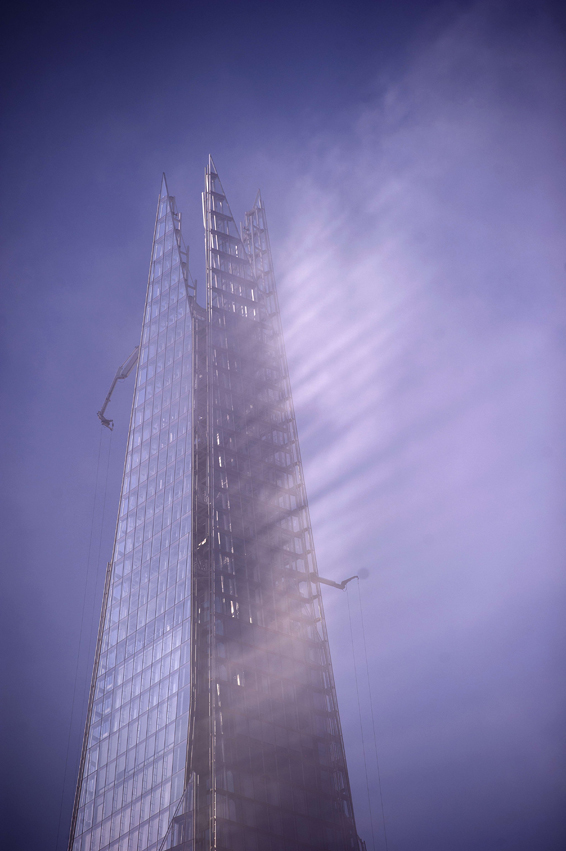 Early morning sunlight is reflected thro...Early morning sunlight is reflected through fog from the top of The Shard building in central London, on April 30, 2014. AFP PHOTO / CARL COURTCARL COURT/AFP/Getty Images