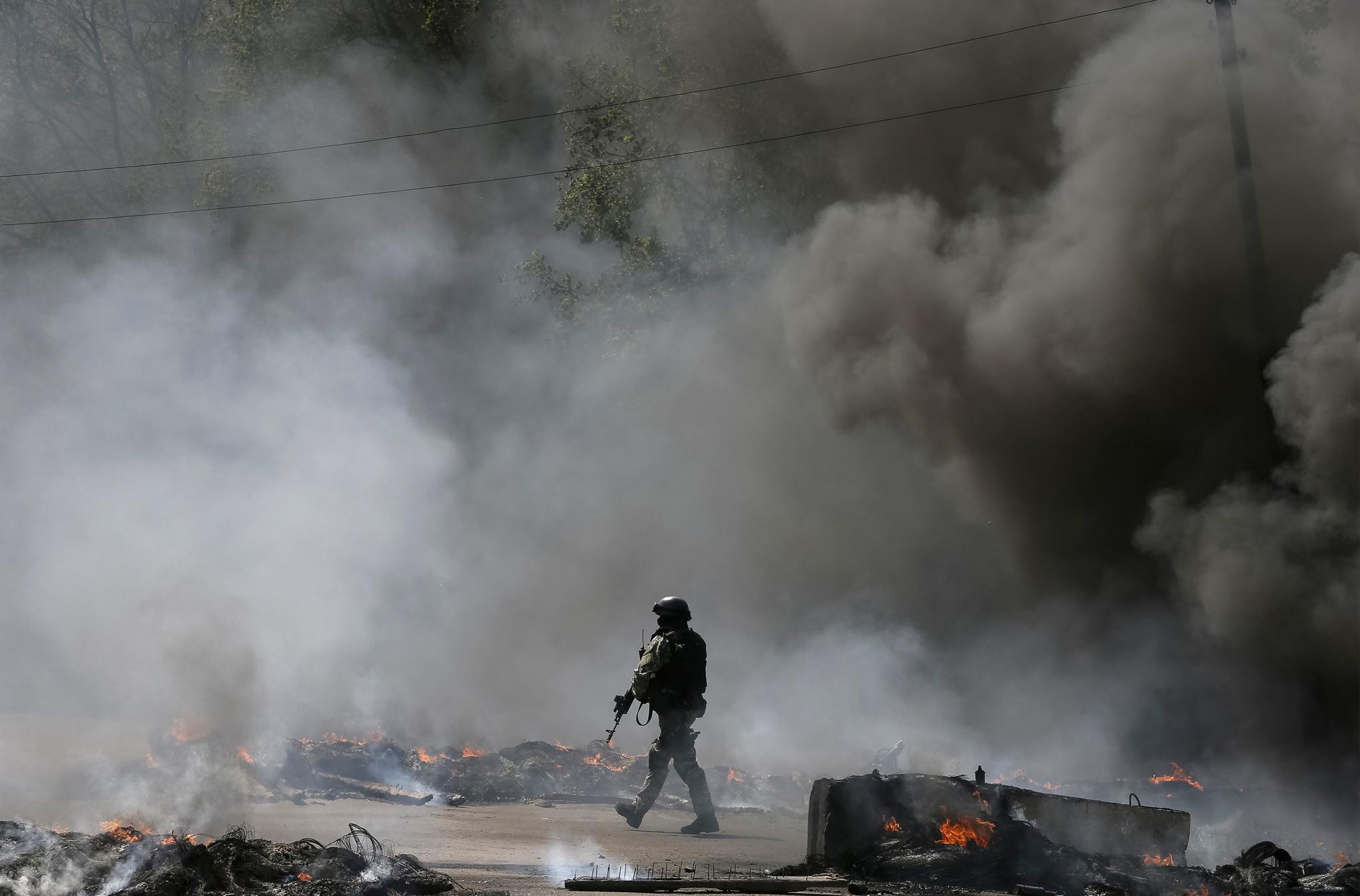 "A Ukrainian security force officer is deployed at a checkpoint set on fire and left by pro-Russian separatists near Slaviansk. REUTERS/Gleb Garanich     REUTERS NEWS PICTURES HAS NOW MADE IT EASIER TO FIND THE BEST PHOTOS FROM THE MOST IMPORTANT STORIES AND TOP STANDALONES EACH DAY. Search for ""TPX"" in the IPTC Supplemental Category field or ""IMAGES OF THE DAY"" in the Caption field and you will find a selection of 80-100 of our daily Top Pictures."