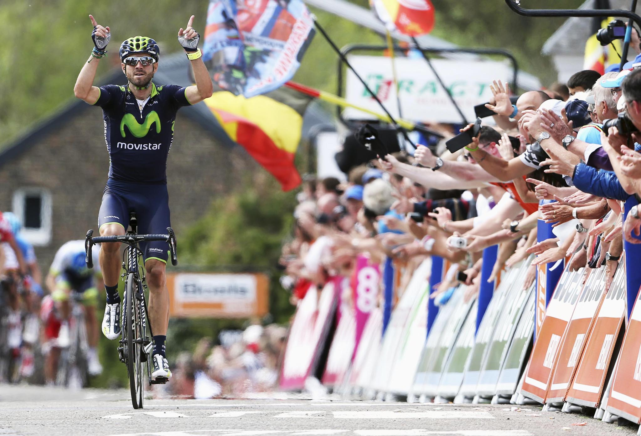 Movistar team rider Valverde of Spain wins the Fleche Wallonne Classic cycling race in Huy