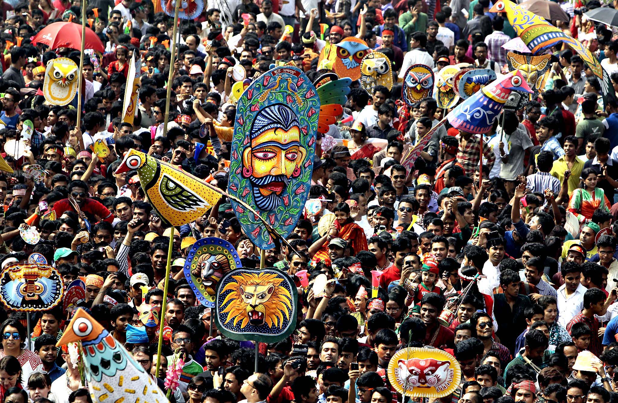 Bangladeshi people participate in a parade to celebrate the first day of the Bangla New Year or Pahela Baisshakh, in Dhaka, Bangladesh, Monday, April 14, 2014. Thousands of Bangladeshis on Monday celebrated their new year with fairs, concerts and rallies.