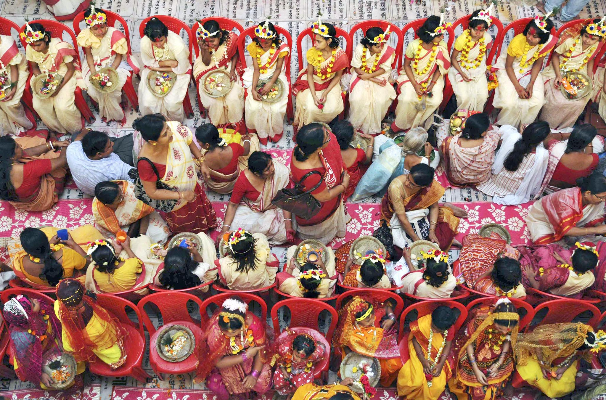 Hindu girls dressed up as Kumari wait for rituals to start during Ramnavmi festival on outskirts of Kolkata