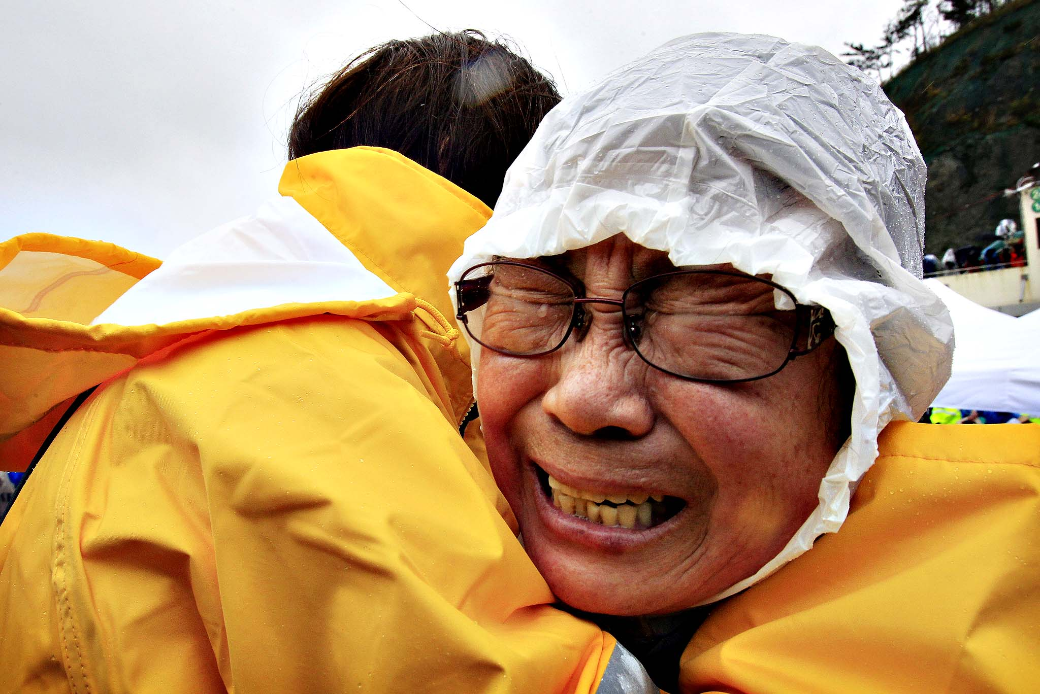 A relative of a passenger aboard a sunken ferry weeps at a port in Jindo, South Korea, Thursday, April 17, 2014.  Strong currents, rain and bad visibility hampered an increasingly anxious search Thursday for more than 280 passengers still missing a day after their ferry flipped onto its side and sank in cold waters off the southern coast of South Korea.