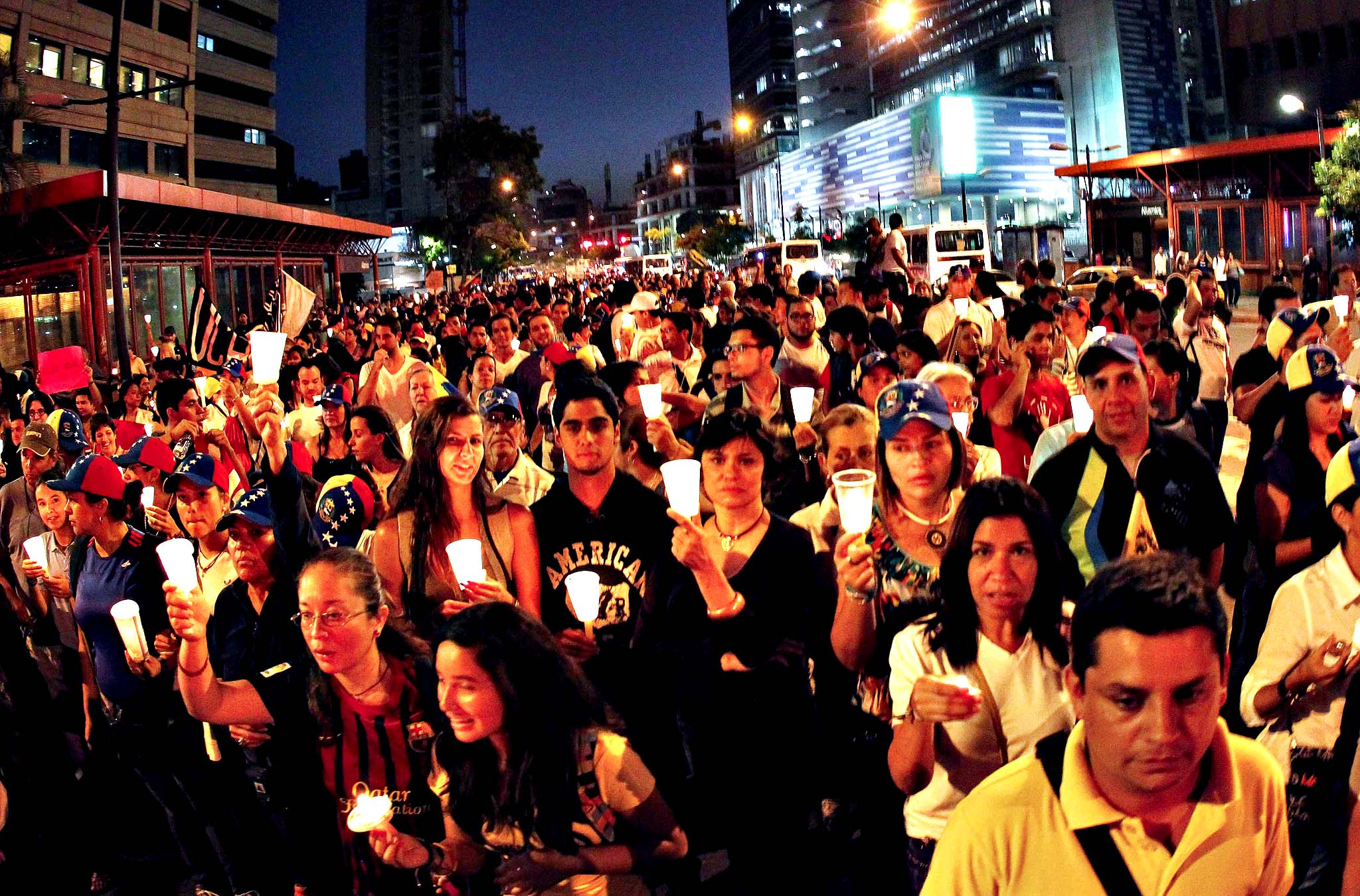 Opposition supporters hold candles as they take part in a rally against Nicolas Maduro's government in Caracas. Venezuela's President Nicolas Maduro was due to host Venezuelan opposition leaders on Thursday at the start of mediated talks intended to stem two months of political unrest that has killed dozens in the OPEC nation.