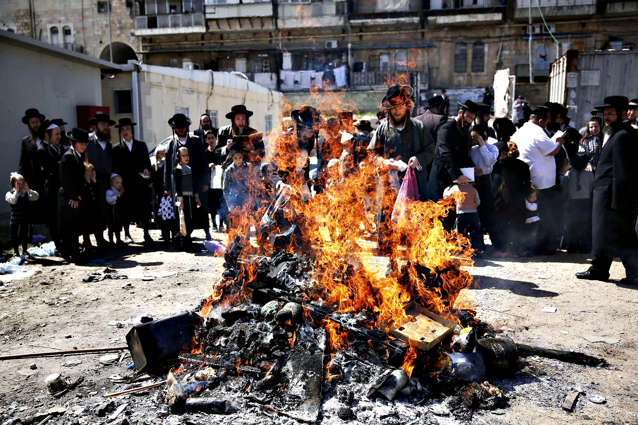 Ultra-Orthodox Jews burn leavened items in a final preparation before the start at sundown of the Jewish Pesach (Passover) holiday, on April 14, 2014 in Jerusalem. Religious Jews worldwide eat matzoth during the eight-day Pesach holiday that commemorates the Israelis' exodus from Egypt some 3,500 years ago and their ancestors' plight by refraining from eating leavened food products.