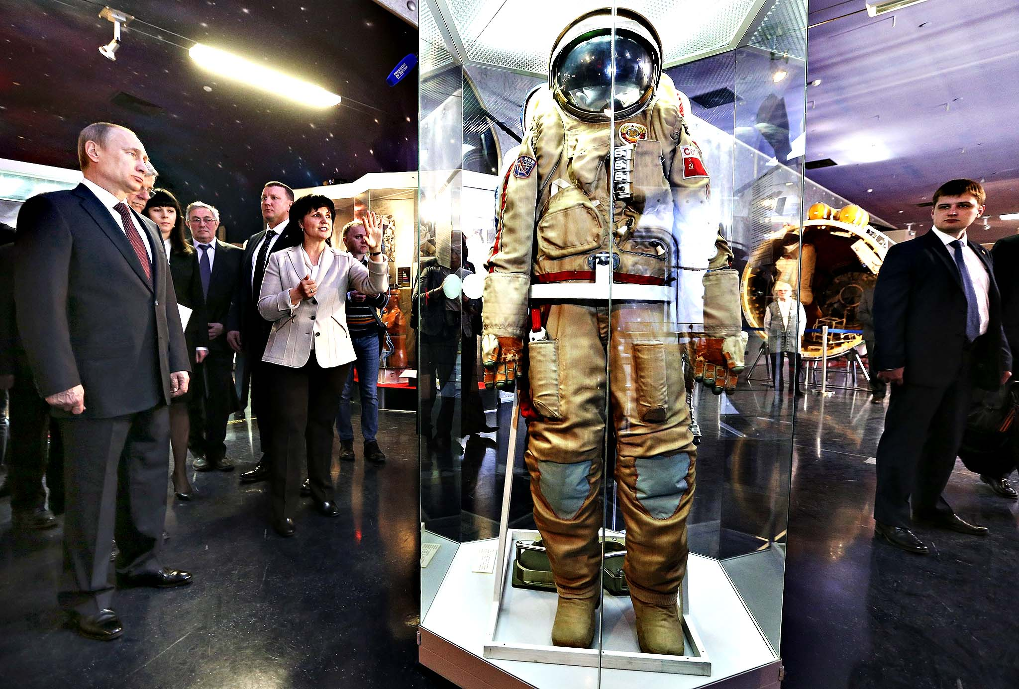Russia's President Vladimir Putin (L) listens to explanations and looks at an exhibit as he visits the Cosmonautics Memorial Museum in Moscow, Russia, 11 April 2014.