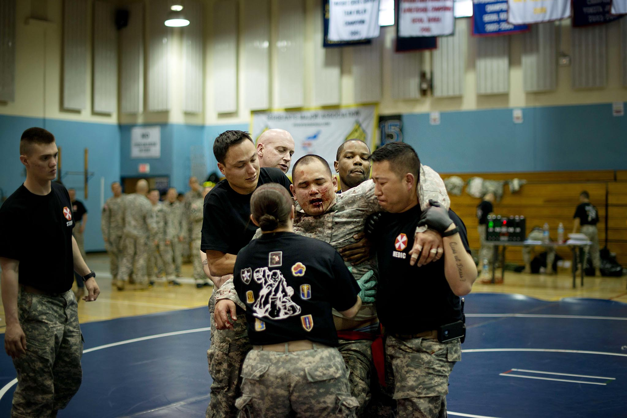 A member of the US 8th Army recieves assistance