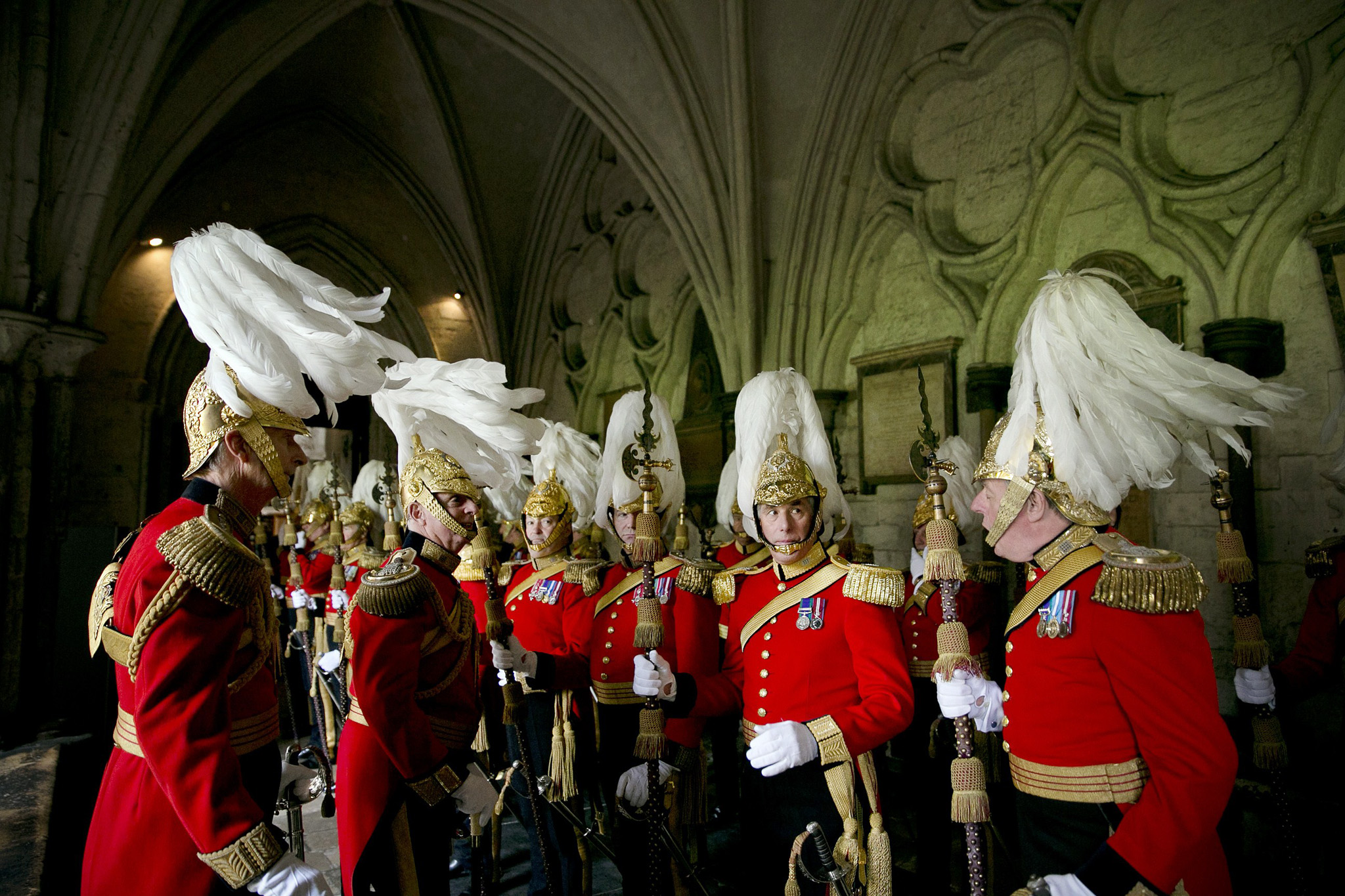 Her Majesty's Body Guard of the Honourab...Her Majesty's Body Guard of the Honourable Corps of Gentlemen muster in the Abbey cloisters ahead of the arrival of Britain's Queen Elizabeth II to attend the Order of the Bath Service at Westminster Abbey  in London on May 9, 2014. The service, held every four years, is always attended by Prince Charles but he is joined every eighth year by the Queen, who was last present in May 2006. The Queen is Sovereign Head of the military order while Charles is its Great Master. It originated in the medieval period when the honour was only conferred on a knight after he had performed a number of rituals designed to purify the inner soul - fasting, vigils and prayer, and cleansing by bathing. George I revived it in 1725 as a regular military order, to serve the purposes of the then prime minister, Sir Robert Walpole, who required an additional source for political reward. The Order dates back to 1725 and uses Henry VII's Chapel in Westminster Abbey as its Chapel. The Queen is Sovereign Head of the Order of the Bath and Prince Charles is its Great Master. AFP PHOTO / ADRIAN DENNIS WPA POOLADRIAN DENNIS/AFP/Getty Images