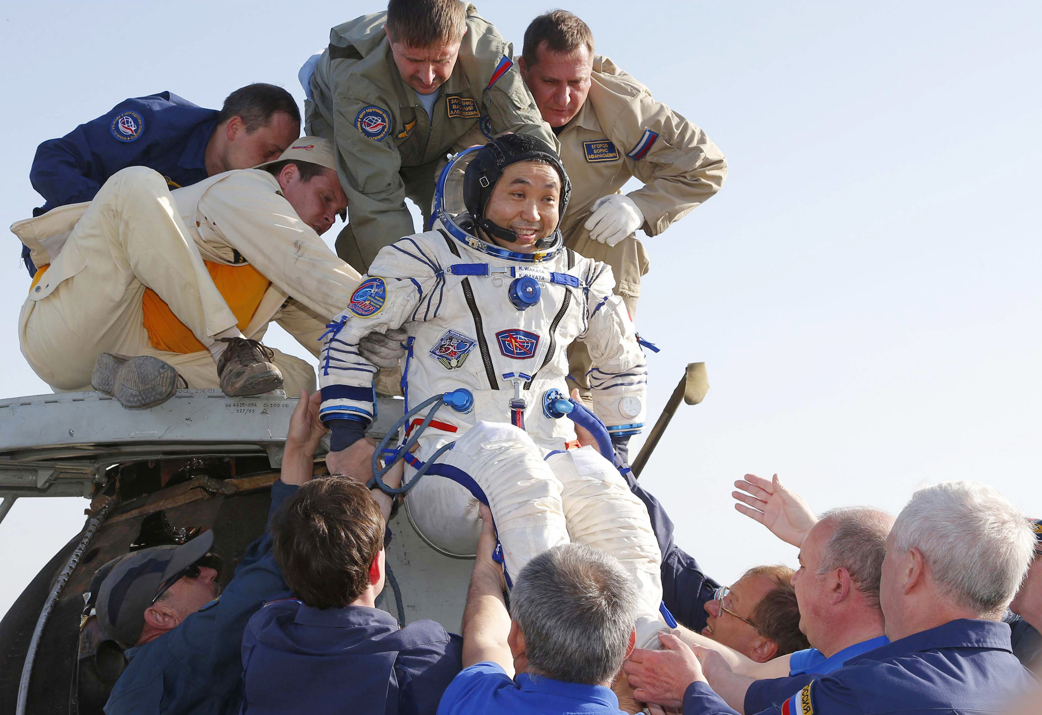 "REUTERS PICTURE HIGHLIGHT...ATTENTION EDITORS - REUTERS PICTURE HIGHLIGHT TRANSMITTED BY 0323 GMT ON MAY 14, 2014    SZH03  International Space Station (ISS) crew member Japanese astronaut Koichi Wakata is helped by ground search and rescue personnel after landing south-east of the town of Dzhezkazgan in central Kazakhstan. REUTERS/Dmitry Lovetsky/Pool      REUTERS NEWS PICTURES HAS NOW MADE IT EASIER TO FIND THE BEST PHOTOS FROM THE MOST IMPORTANT STORIES AND TOP STANDALONES EACH DAY. Search for ""TPX"" in the IPTC Supplemental Category field or ""IMAGES OF THE DAY"" in the Caption field and you will find a selection of 80-100 of our daily Top Pictures."