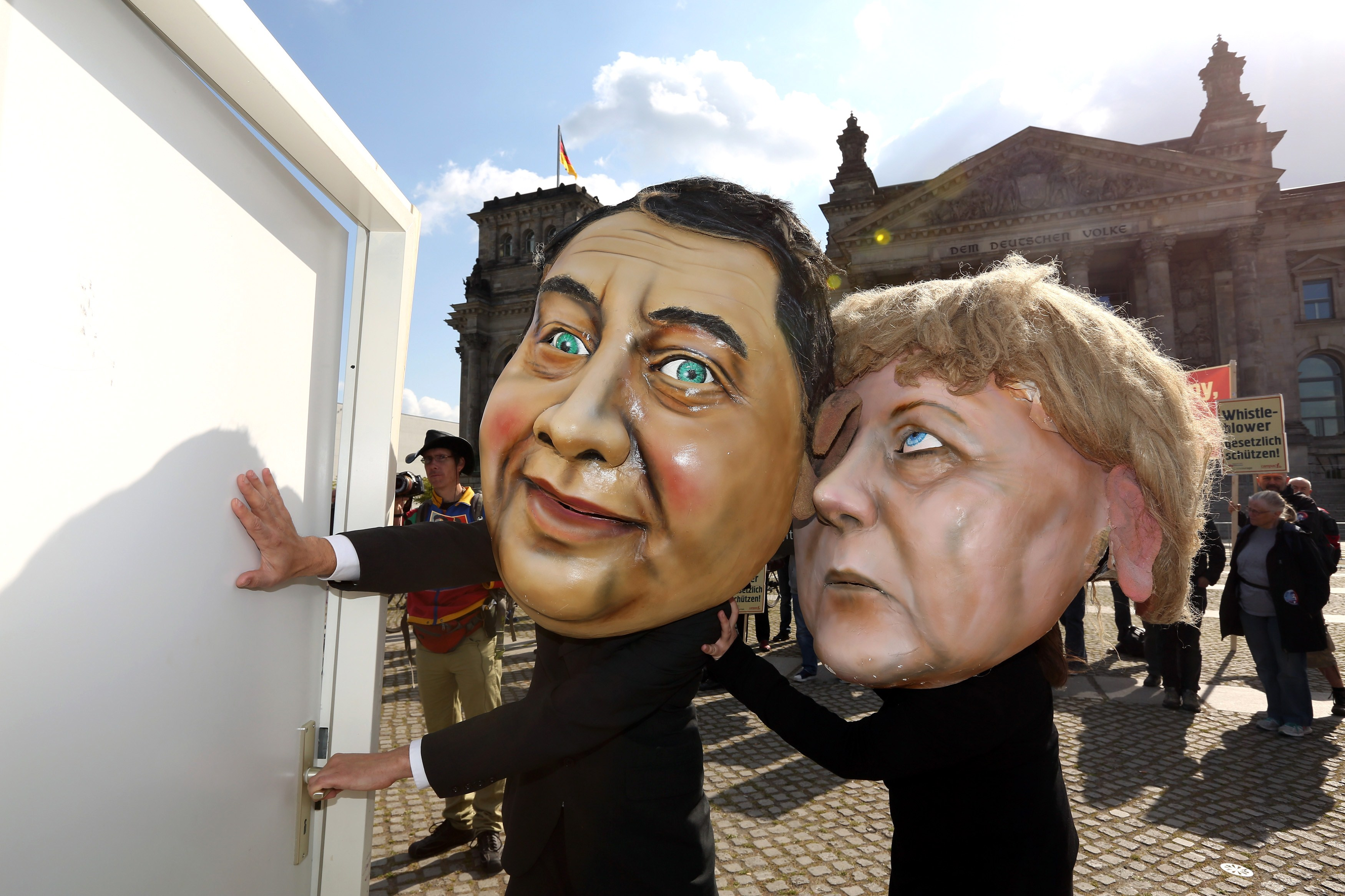 Activists wearing masks of German Chance...Activists wearing masks of German Chancellor Angela Merkel and vice chancellor and Economy and Energy Minister Sigmar Gabriel take part in a demonstration in favor of an appearance by fugitive US intelligence leaker Edward Snowden as a witness in German NSA hearings held in the German Bundestag, or lower house of parliament, outside the Reichstag building in Berlin on May 8, 2014. Lawmakers from the opposition Greens and far-left Linke parties had demanded that the parliamentary panel probing mass surveillance by the NSA seek testimony from Snowden, the former contractor with the US National Security Agency (NSA) now living in Moscow.       AFP PHOTO / ADAM BERRYADAM BERRY/AFP/Getty Images