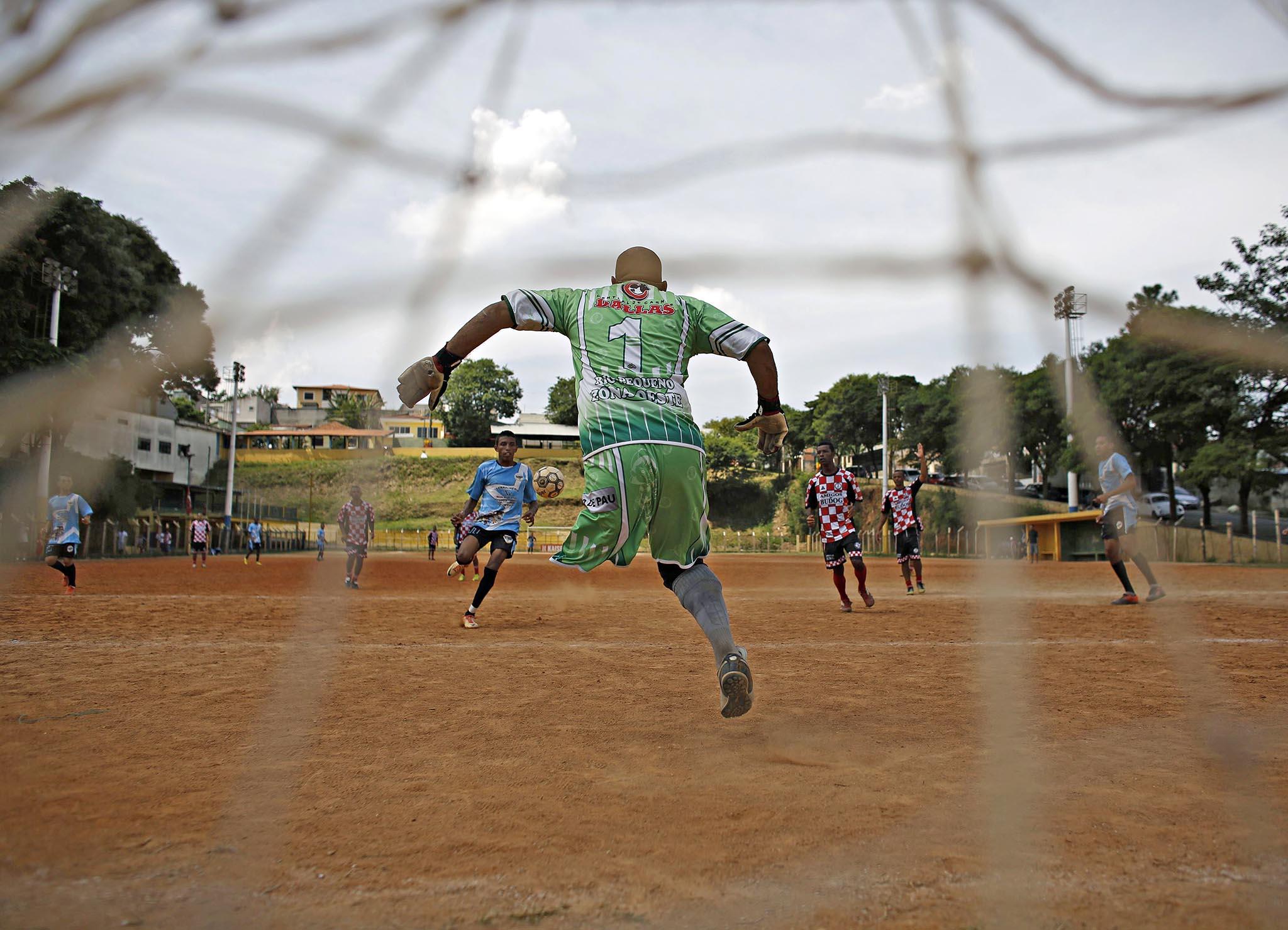 Moleque Travesso soccer club's goalkeeper Alexandre Toledo