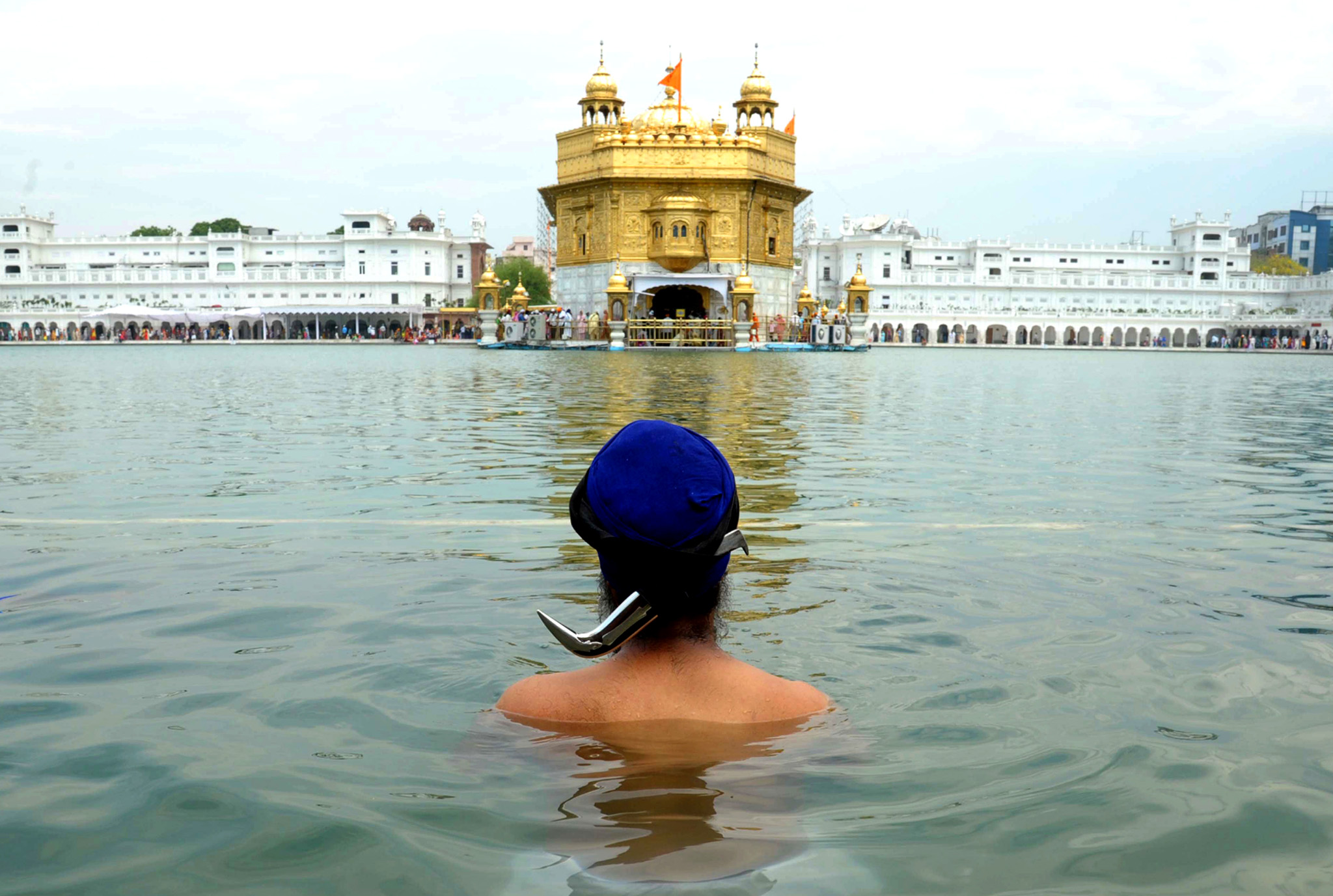 n Indian Sikh devotee takes a dip in the sarover (water tank) at the Sikh Shrine Golden temple in Amritsar on May 23, 2014, on the occasion of the 535th birth anniversary of Guru Amardas, the third master of the Sikhs. Guru Amardas lived from May 5, 1479 to September 1, 1574 and was the third of the 10 Gurus of Sikhism and was given the title of Sikh Guru on March 26, 1552.  AFP PHOTO/NARINDER NANUNARINDER NANU/AFP/Getty Images