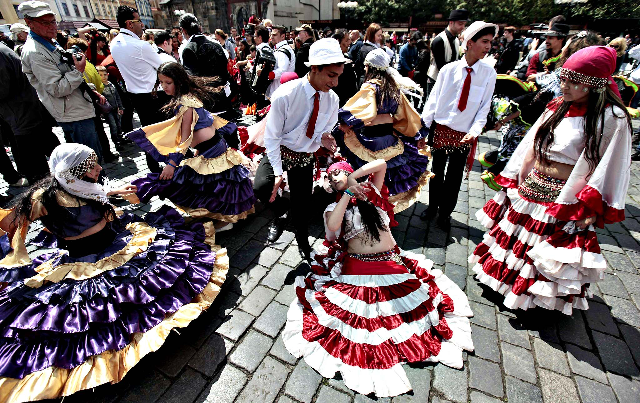 Participants of the Khamoro World Roma Festival dance through the historical centre of Prague May 30, 2014. The festival aims to showcase Roma culture and improve relations between society and members of the Roma community, according to the organisers.