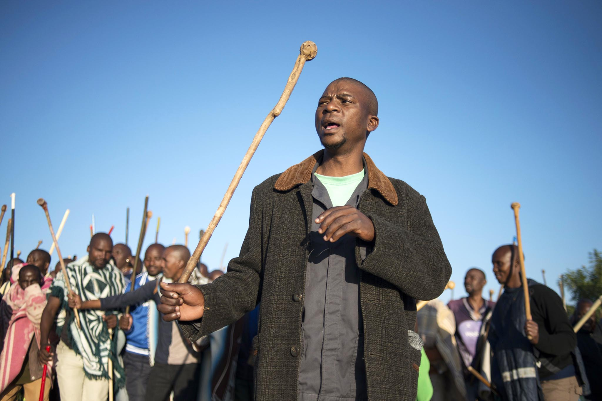 Striking miners march in Marikana