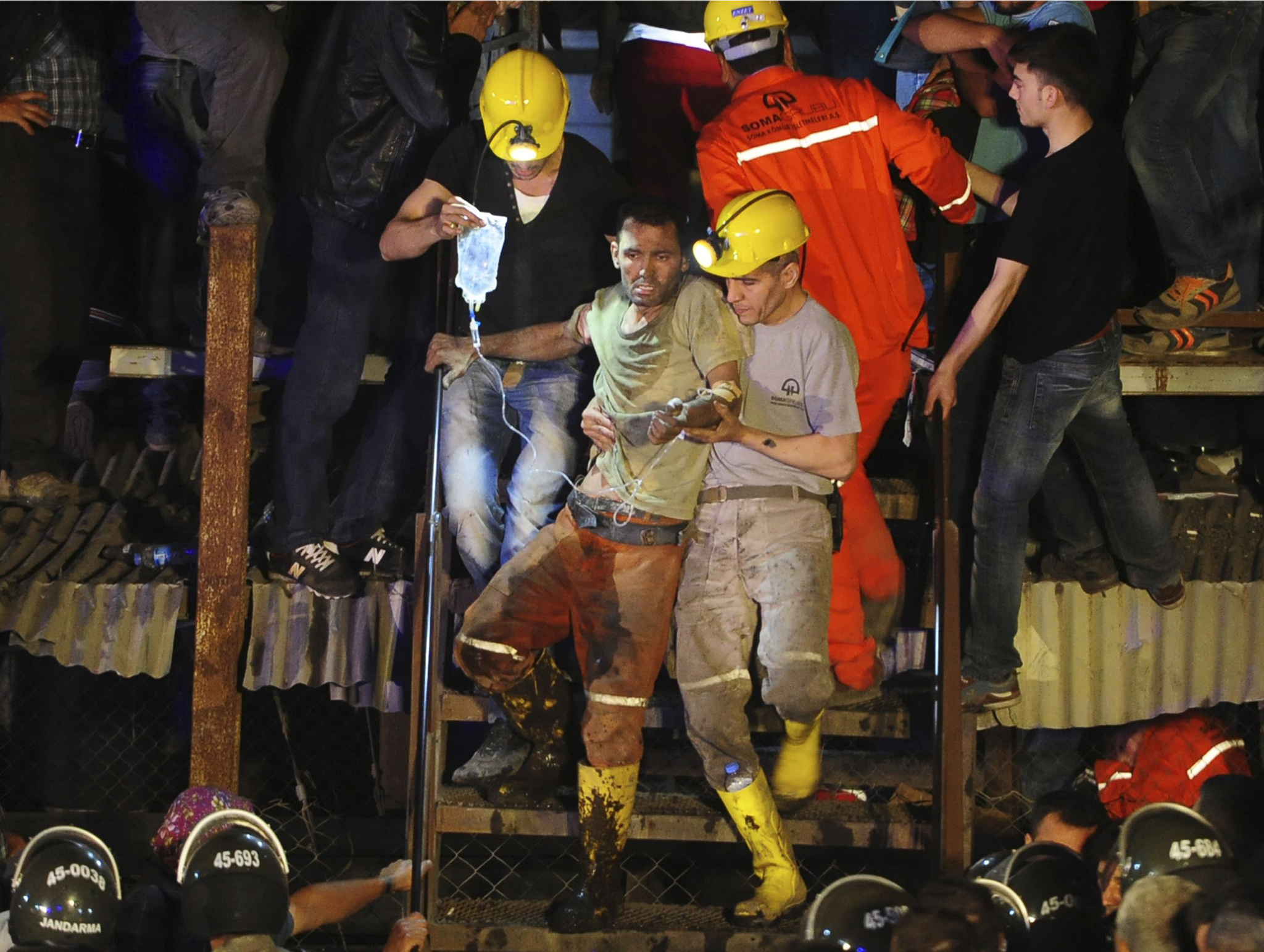 An injured miner is carried to an ambulance after being rescued from a coal mine he was trapped in Soma...An injured miner is carried to an ambulance after being rescued from a coal mine he was trapped in, in Soma, a district in Turkey's western province of Manisa, late May 13, 2014. Rescuers pulled more dead and injured from the coal mine in western Turkey on Wednesday more than 12 hours after an explosion, bringing the death toll to 201 in the nation's worst mining disaster for decades. Hundreds more were still believed to be trapped in the mine in Soma, around 120 km (75 miles) northeast of the Aegean coastal city of Izmir. The explosion, which triggered a fire, occurred shortly after 3 pm (1200 GMT) on Tuesday. REUTERS/Emre Tazegul