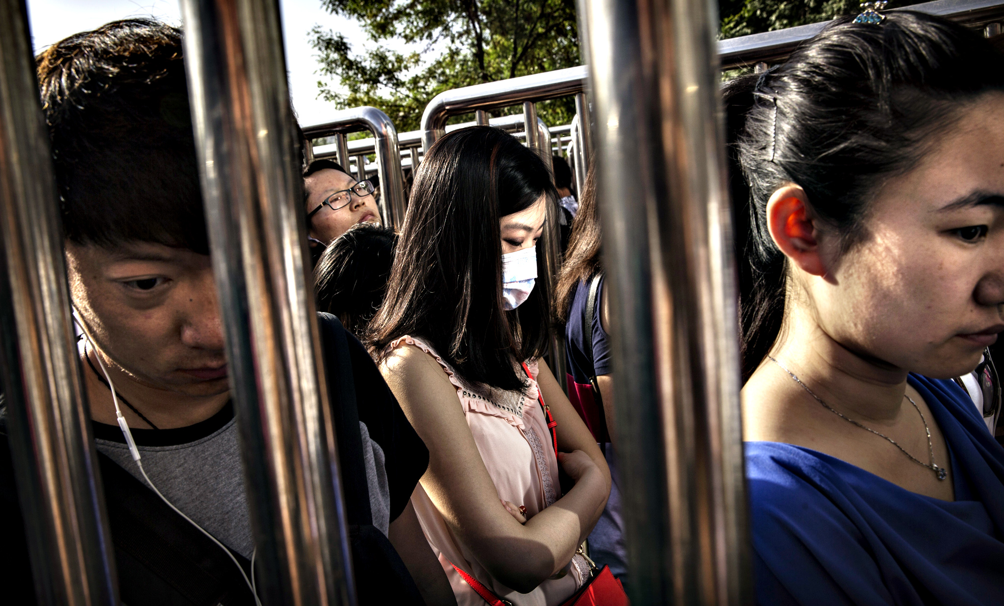 Chinese commuters line-up for a security check at a subway station on May 29, 2014 in Beijing, China. Authorities have increased security in various public locations after an attack left 31 dead in the restive Xinjiang Province last week.