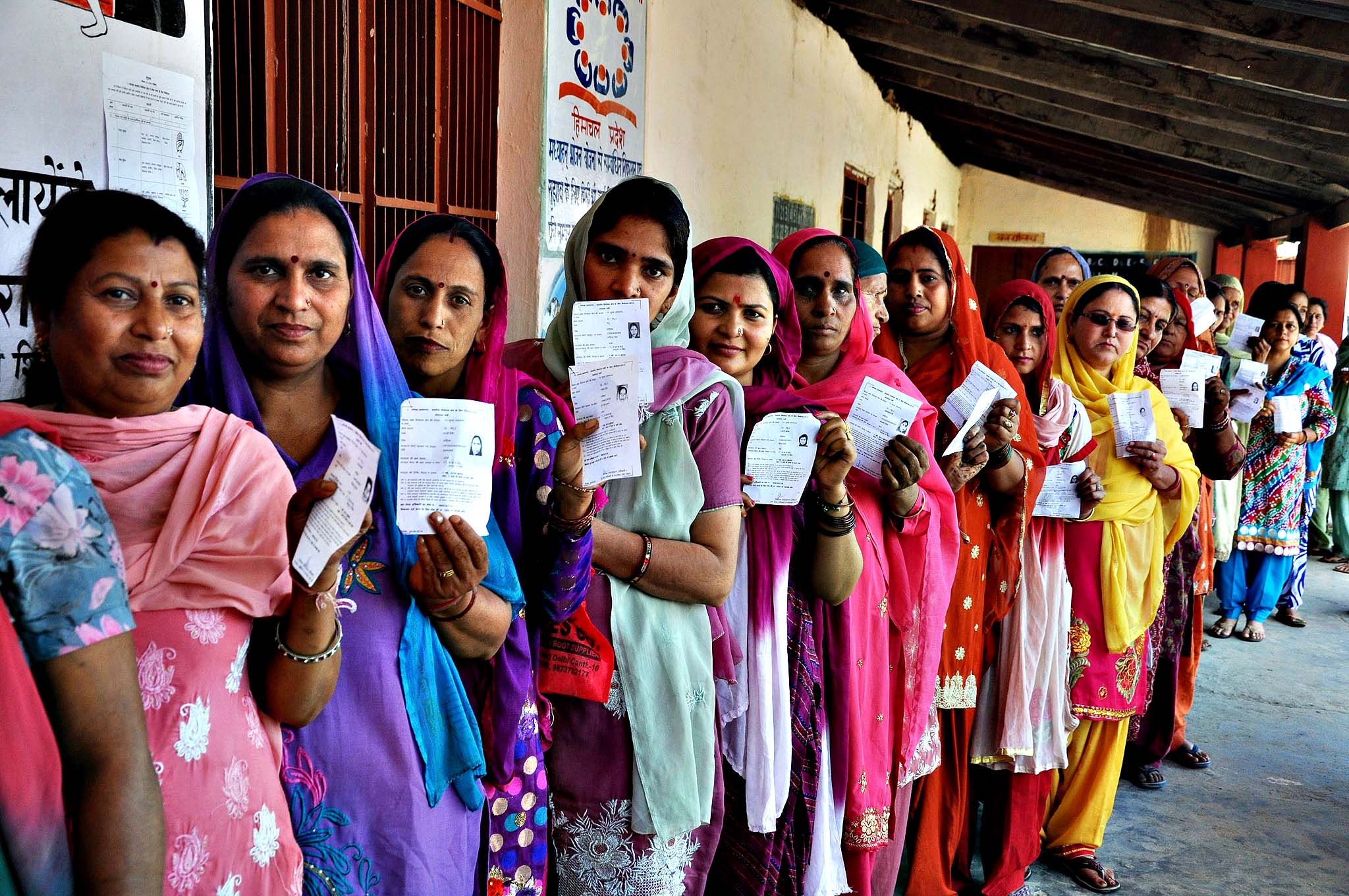 Indian women show their voting slips as they wait to cast their votes at a polling station during the 8th phase of Parliamentary election at Palampur, Himachal Pradesh, India, 07 May 2014. Parliamentary elections in India are being held in nine phases between 07 April and 12 May 2014. A total of 814.6 million people are eligible to vote, around 100 million more than in the elections in 2009.