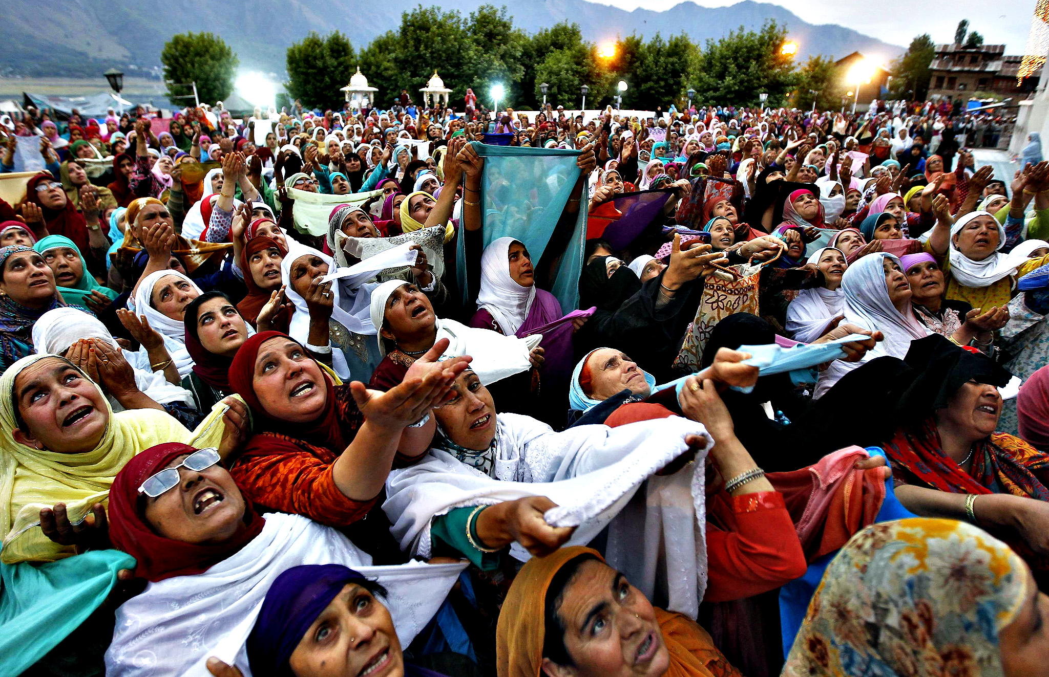 "Kashmiri Muslim women offer prayers on the Friday following celebrations for ""Meeraj-un-Nabi"" at the Hazratbal shrine in Srinagar May 30, 2014. Thousands of Kashmiri Muslims on Friday thronged to Hazratbal shrine, which houses a relic believed to be a hair from the beard of Prophet Mohammed, to celebrate concluding ceremonies of Meeraj-un-Nabi or ascension of Prophet Mohammed to Heaven."