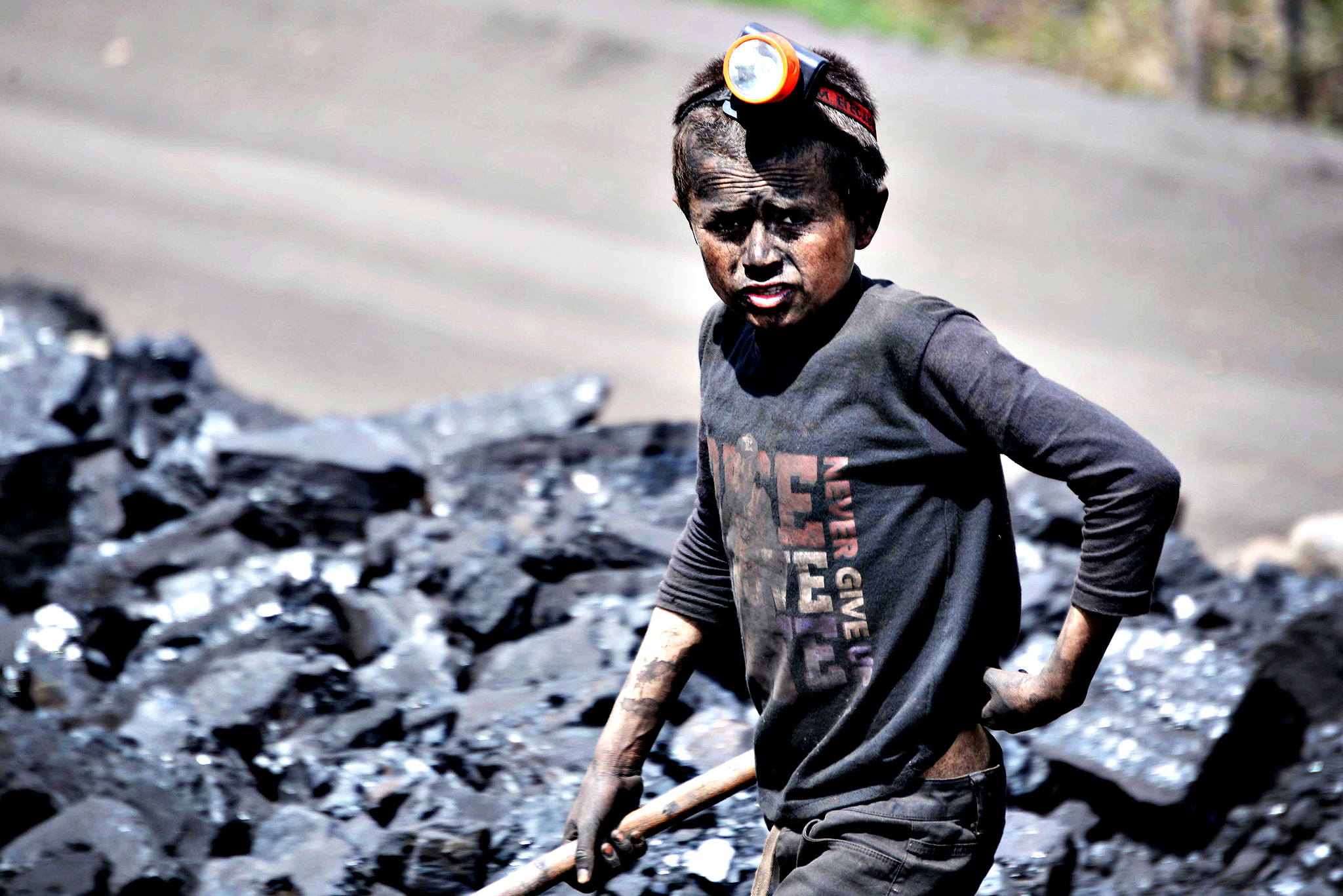 An Afghan child looks on as he works at a coal mine which collapsed on Wednesday killing some 40 miners and trapping an unknown number of others in the Dar-i- Suf district of Samangan province, some 200 kms from Mazar-e-Sharif